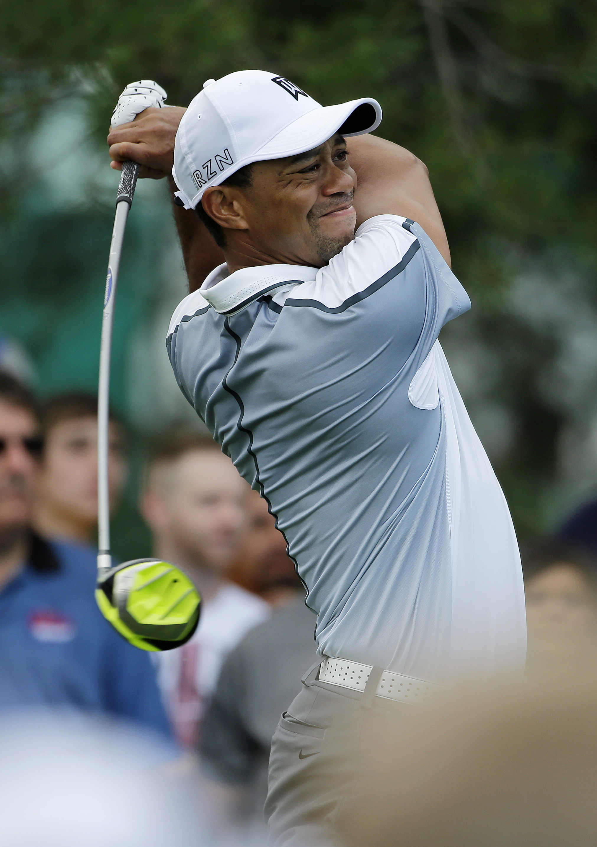 Tiger Woods watches his tee shot on the 11th hole during the first round of the Memorial golf tournament Thursday, June 4, 2015, in Dublin, Ohio. (AP Photo/Darron Cummings)