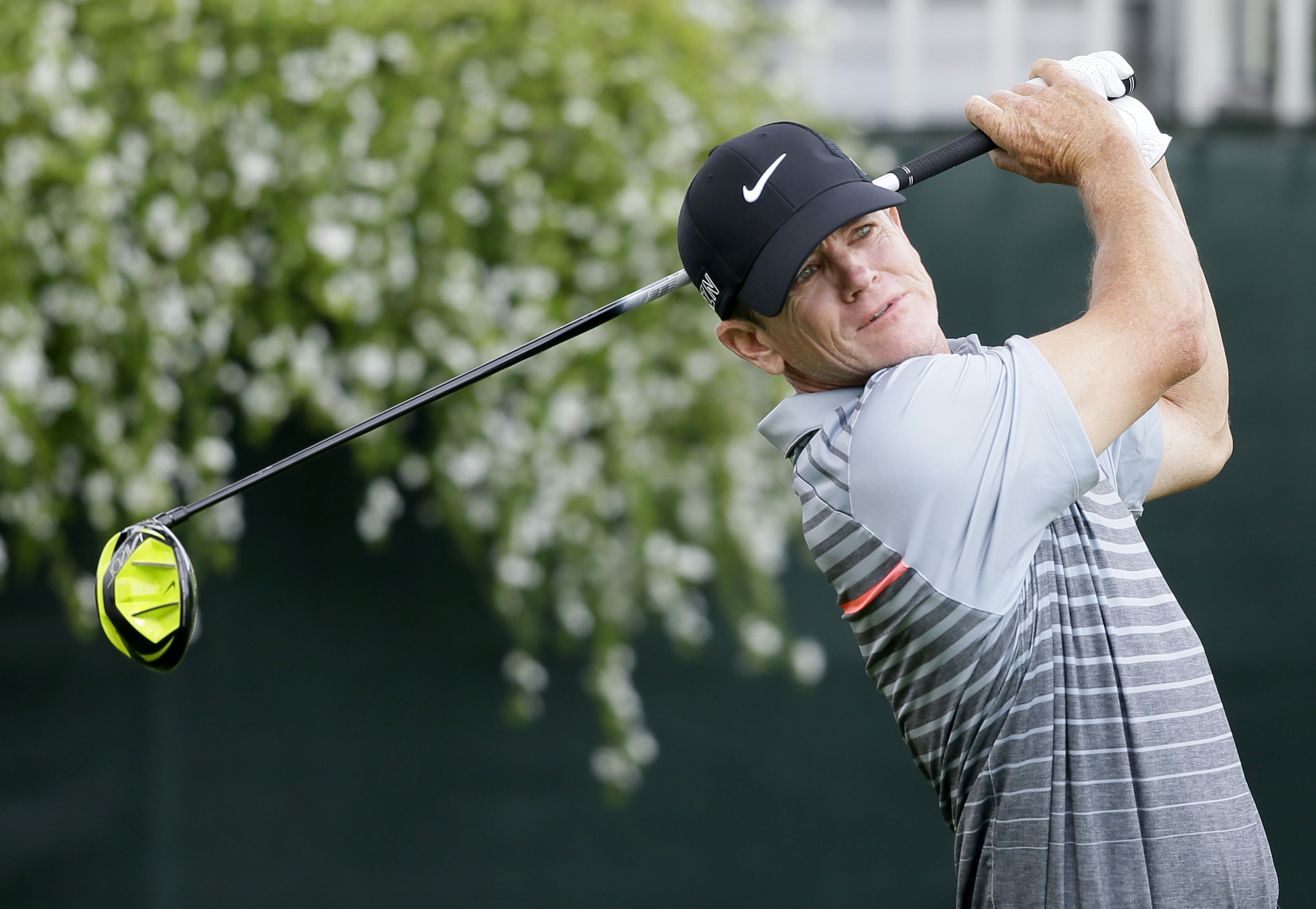 Brian Henninger watches his shot off the first tee during the first round of the Champions Tour's Principal Charity Classic golf tournament, Friday, June 5, 2015, in Des Moines, Iowa. (AP Photo/Charlie Neibergall)