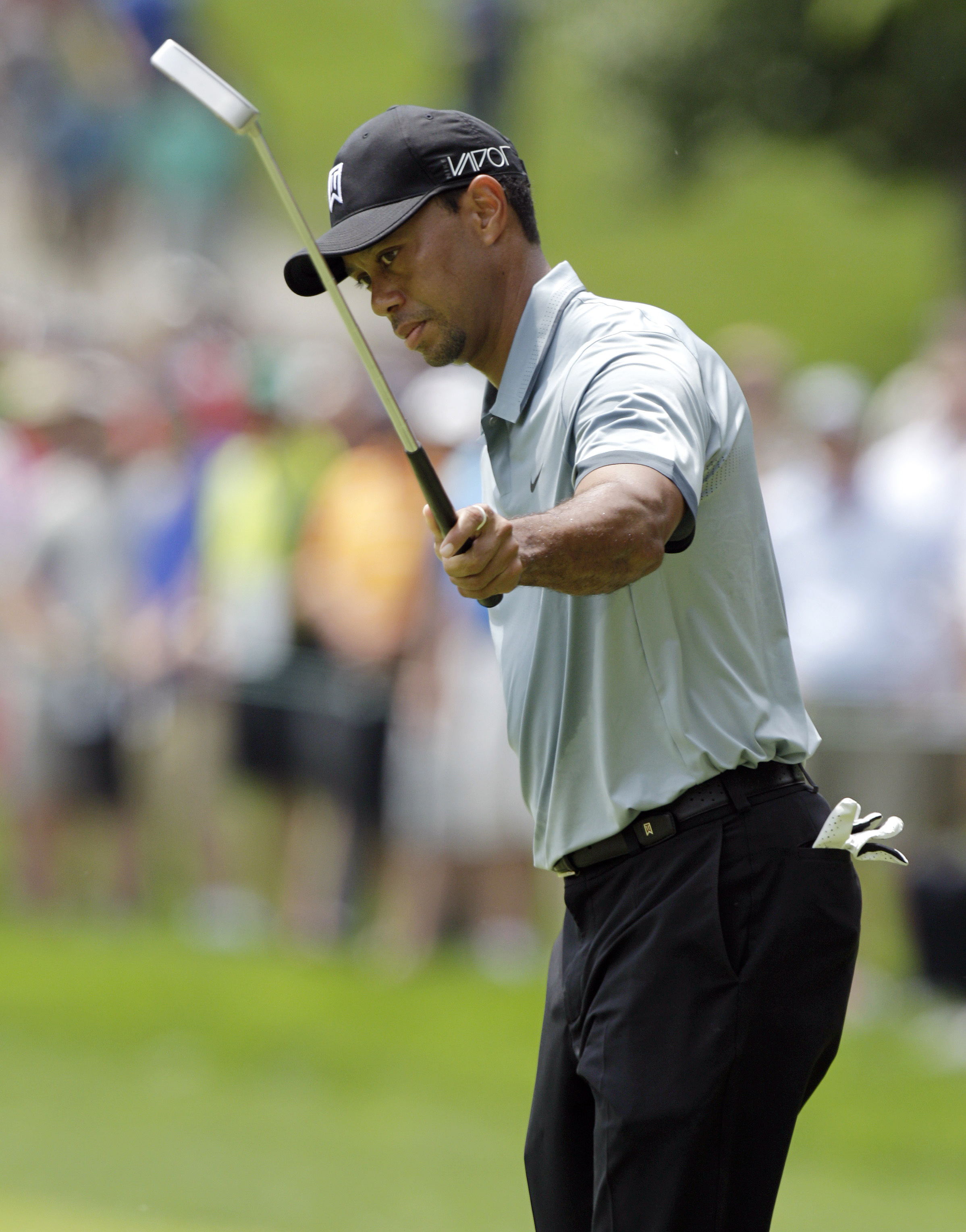 Tiger Woods reacts to making a birdie putt on the second hole during the second round of the Memorial golf tournament, Friday, June 5, 2015, in Dublin, Ohio. (AP Photo/Jay LaPrete)