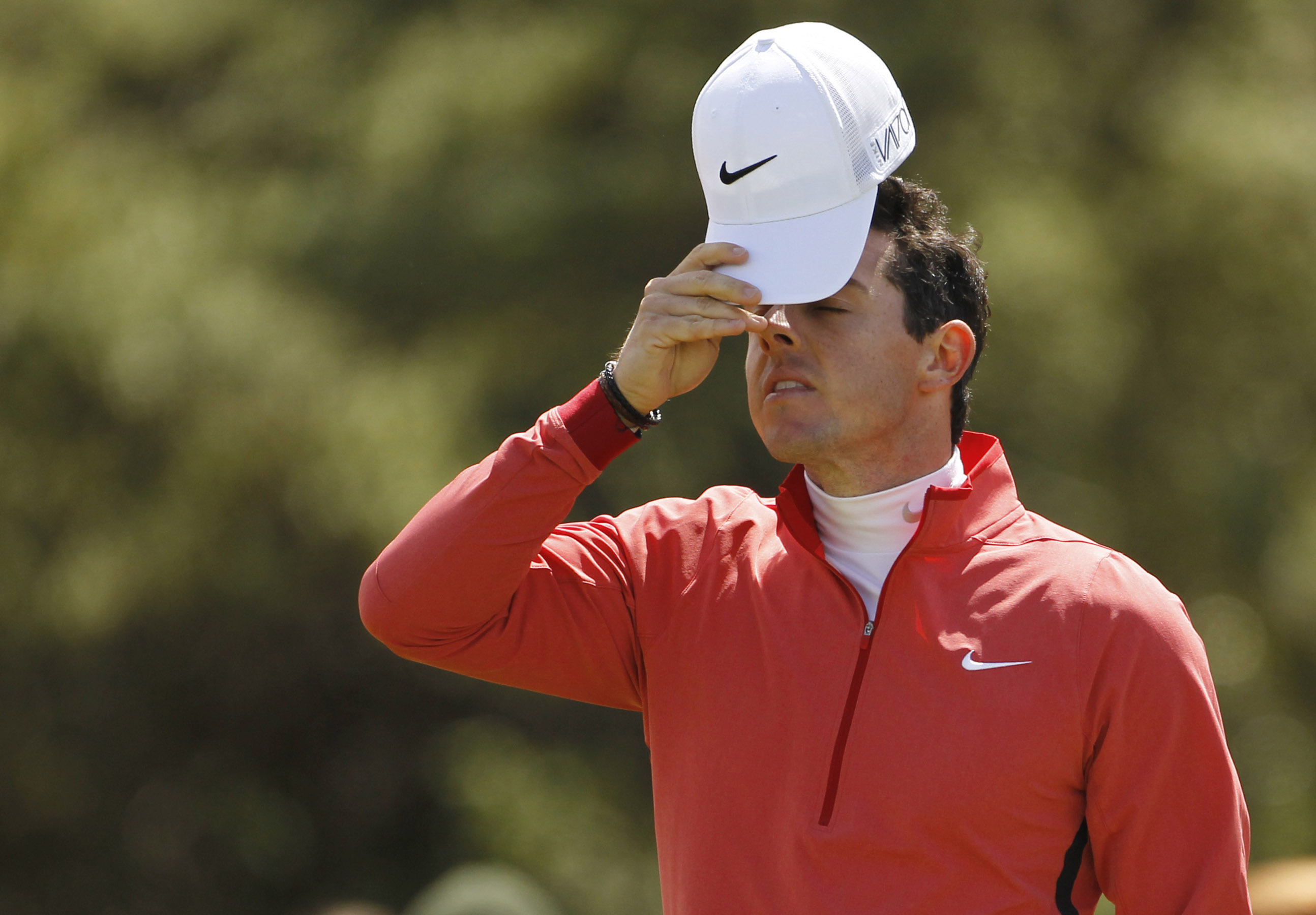 FILE - In this May 28, 2015, file photo, Northern Ireland's Rory McIlroy looks dejected after missing a putt on the ninth hole during the first round of the Irish Open Golf Championship at Royal County Down, Newcastle, Northern Ireland. Returning to the s