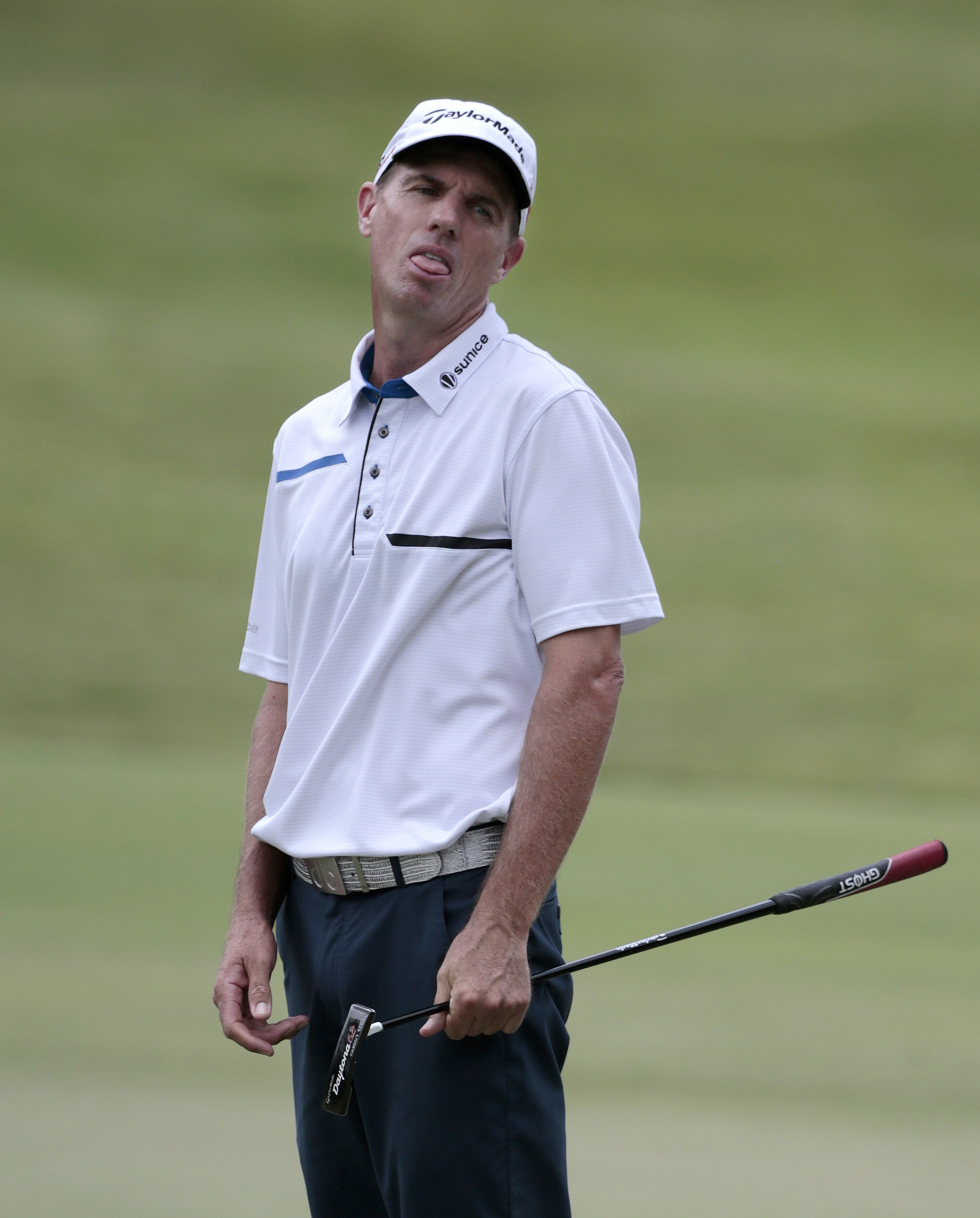Steven Alker, of New Zealand, watches as his birdie putt attempt misses the hole on the fourth green during the third round of the St. Jude Classic golf tournament Saturday, June 13, 2015, in Memphis, Tenn. (AP Photo/Mark Humphrey)