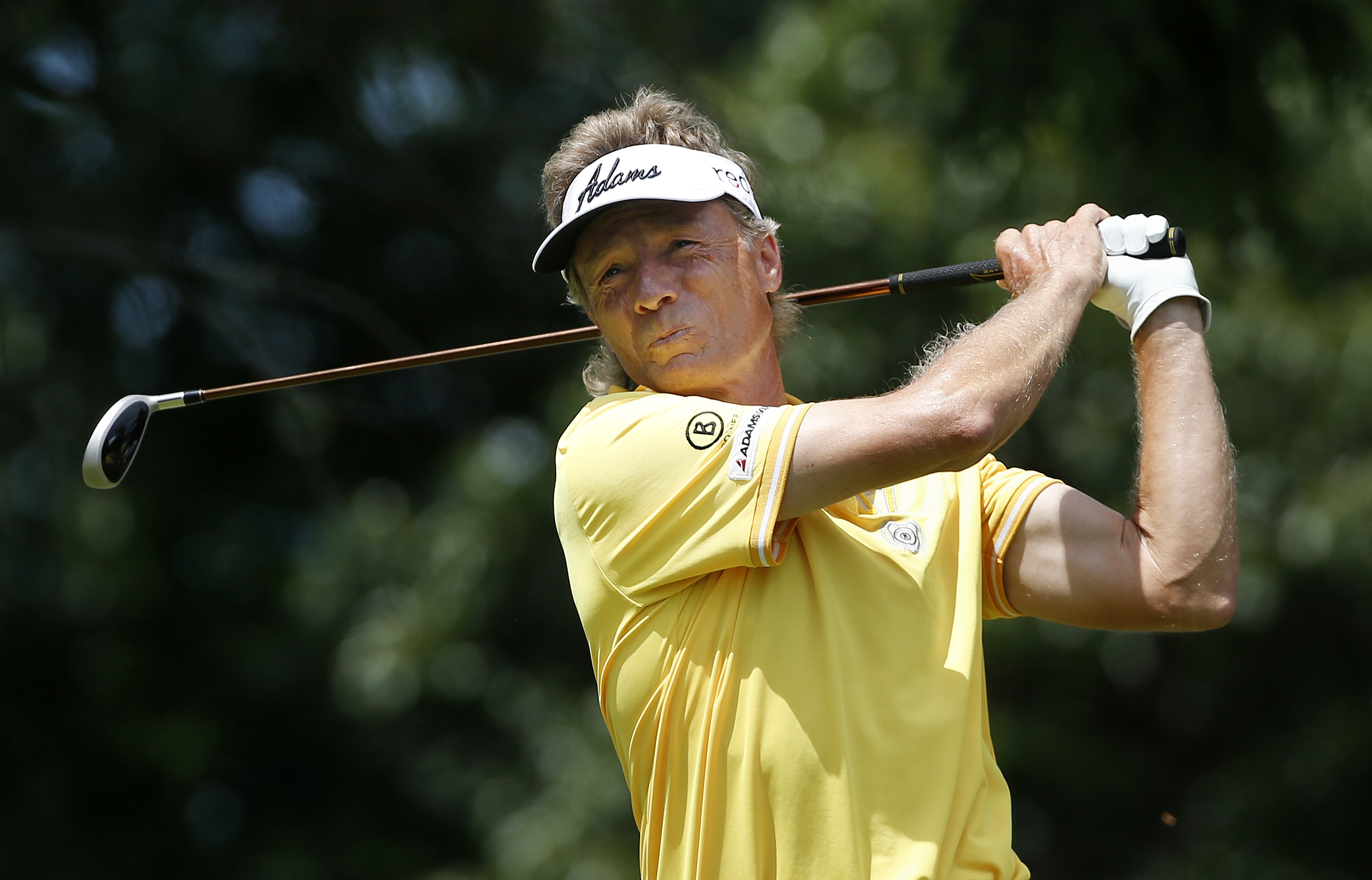 Bernhard Langer, of Germany, tees off on the second hole during the final round of the Senior Players Championship golf tournament in Belmont, Mass., Sunday, June 14, 2015. (AP Photo/Michael Dwyer)