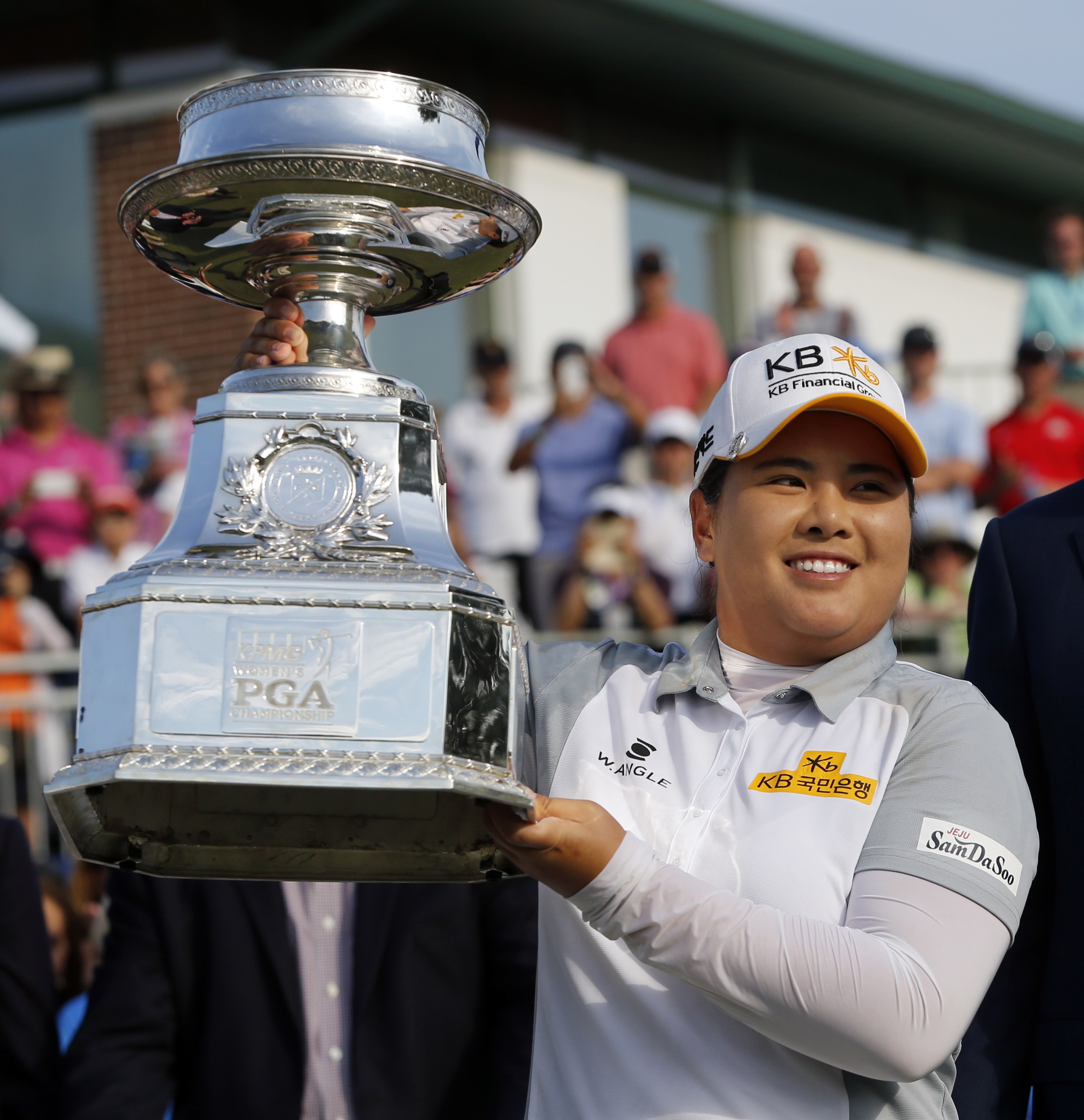 Inbee Park, of South Korea, poses with the trophy after winning the KPMG Women's PGA golf championship at Westchester Country Club in Harrison, N.Y., Sunday, June 14, 2015. (AP Photo/Julio Cortez)