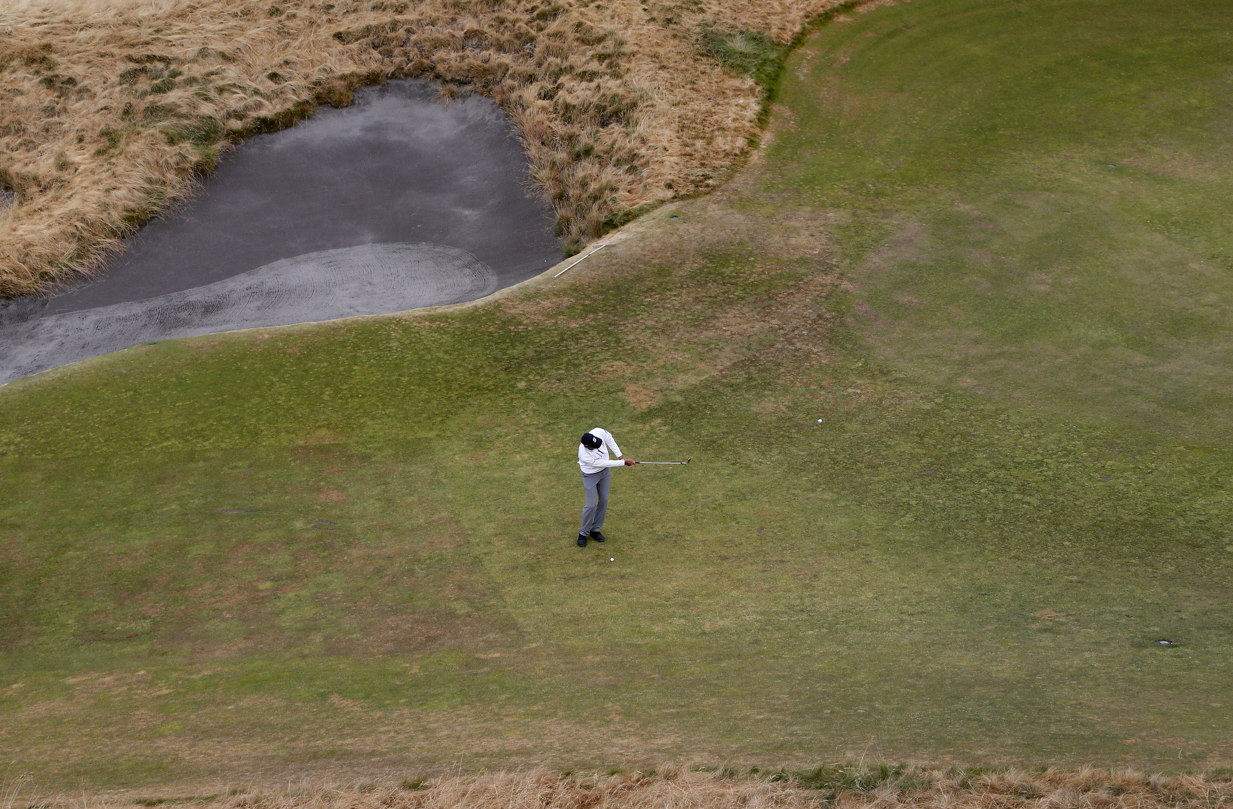 Matt Kuchar hits a chip on the 12th hole during a practice round for the U.S. Open golf tournament at Chambers Bay on Tuesday, June 16, 2015 in University Place, Wash. (AP Photo/Matt York)