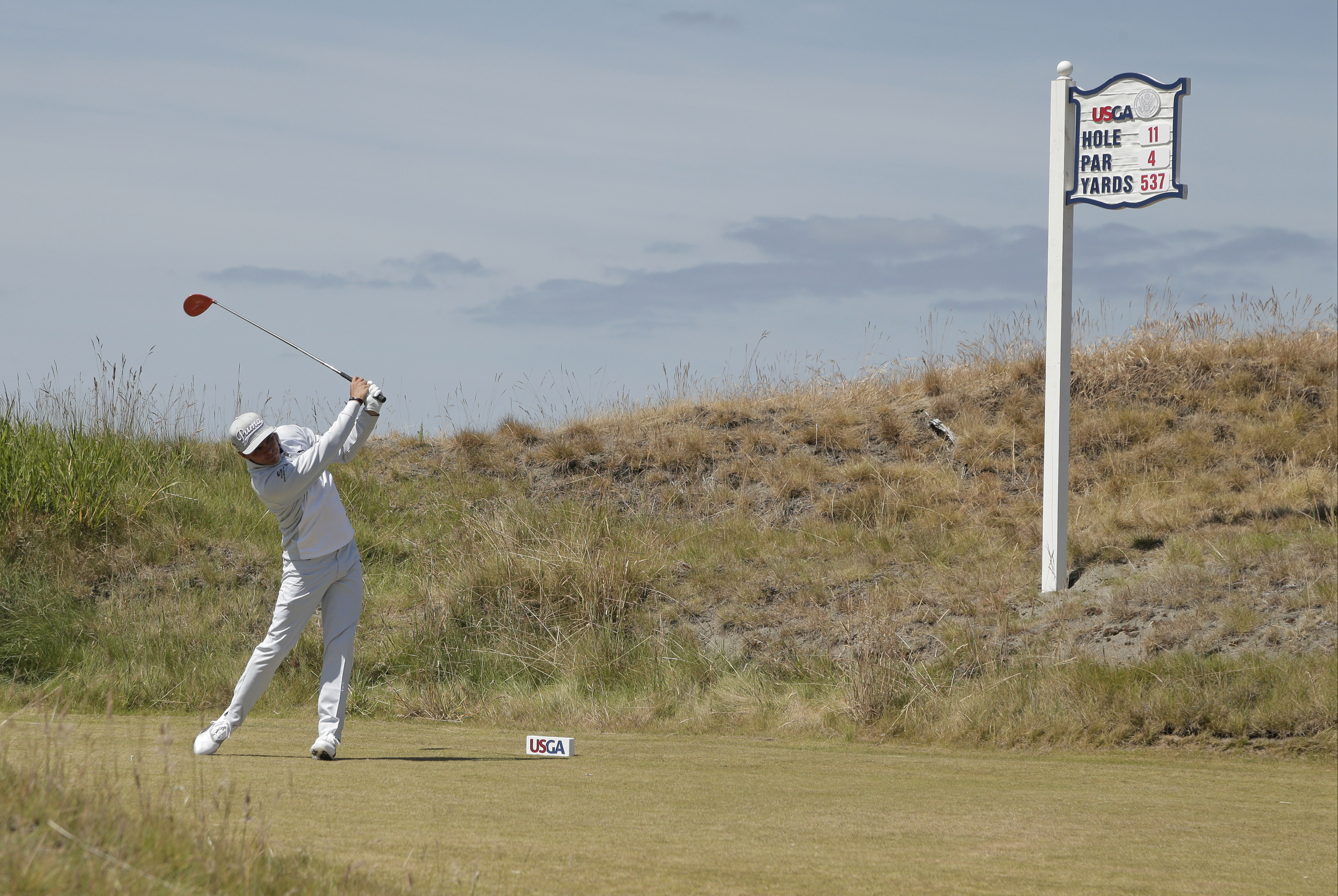 Rickie Fowler watches his tee shot on the 11th hole during a practice round for the U.S. Open golf tournament at Chambers Bay on Tuesday, June 16, 2015 in University Place, Wash. (AP Photo/Charlie Riedel)