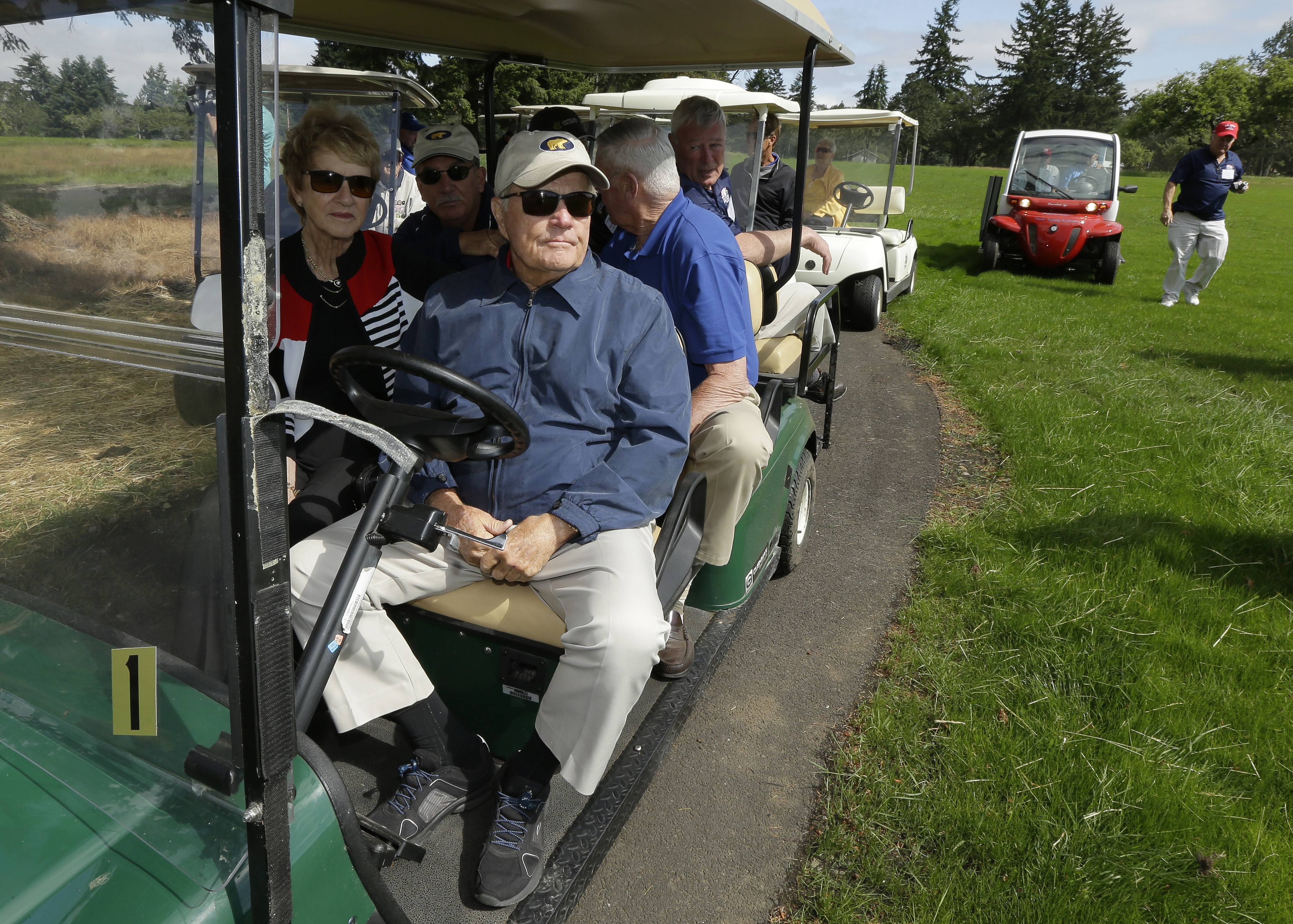 "Golfer Jack Nicklaus, front right, and his wife Barbara, left, pause while driving a golf cart, Tuesday, June 16, 2015, at the American Lake Veterans Golf Course in Tacoma, Wash. Nicklaus was inspecting the progress of the ""Nicklaus Nine,"" nine new golf h"