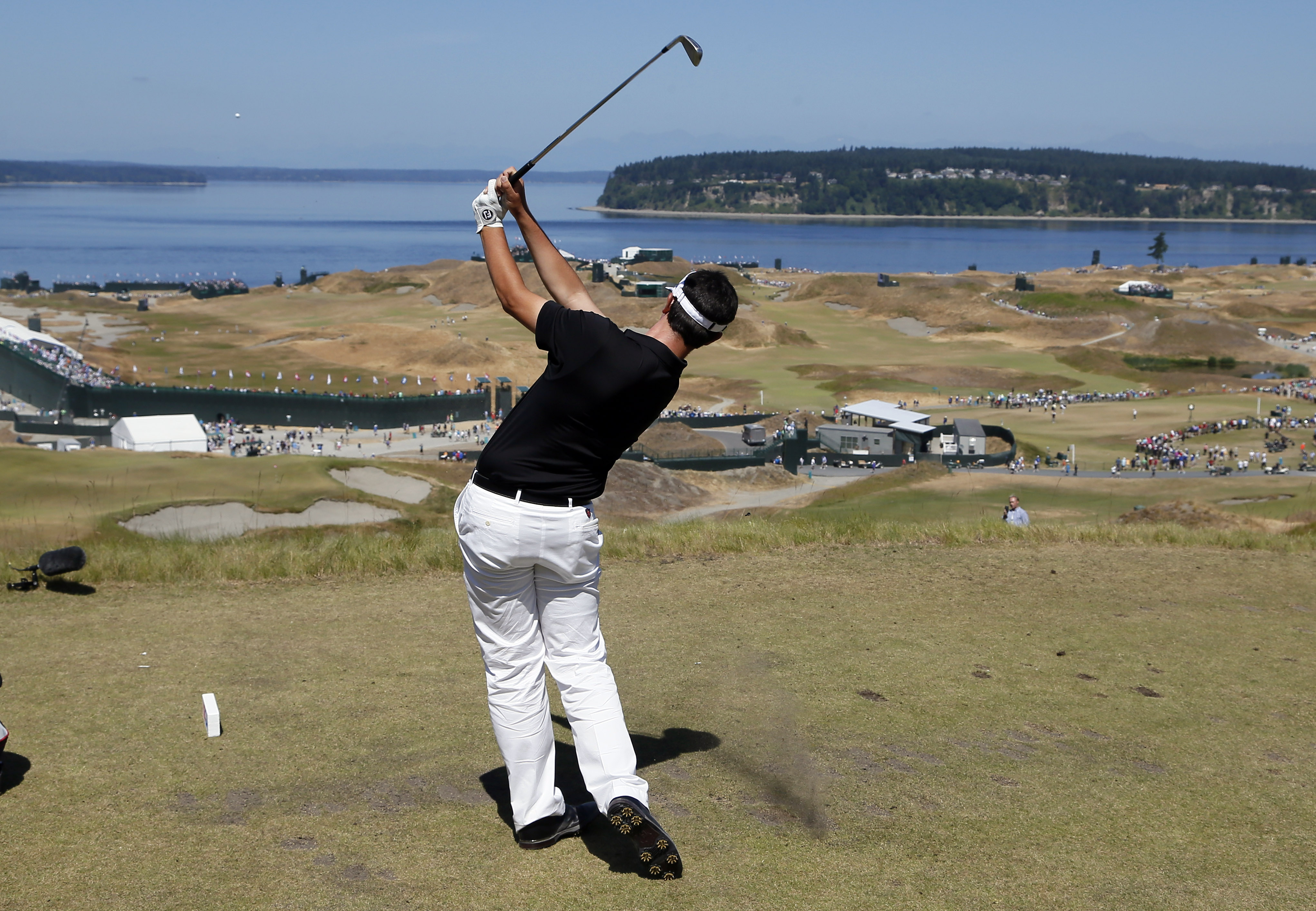 Beau Hossler, amateur, watches his tee shot on the ninth hole during a practice round for the U.S. Open golf tournament at Chambers Bay on Wednesday, June 17, 2015 in University Place, Wash. (AP Photo/Matt York)
