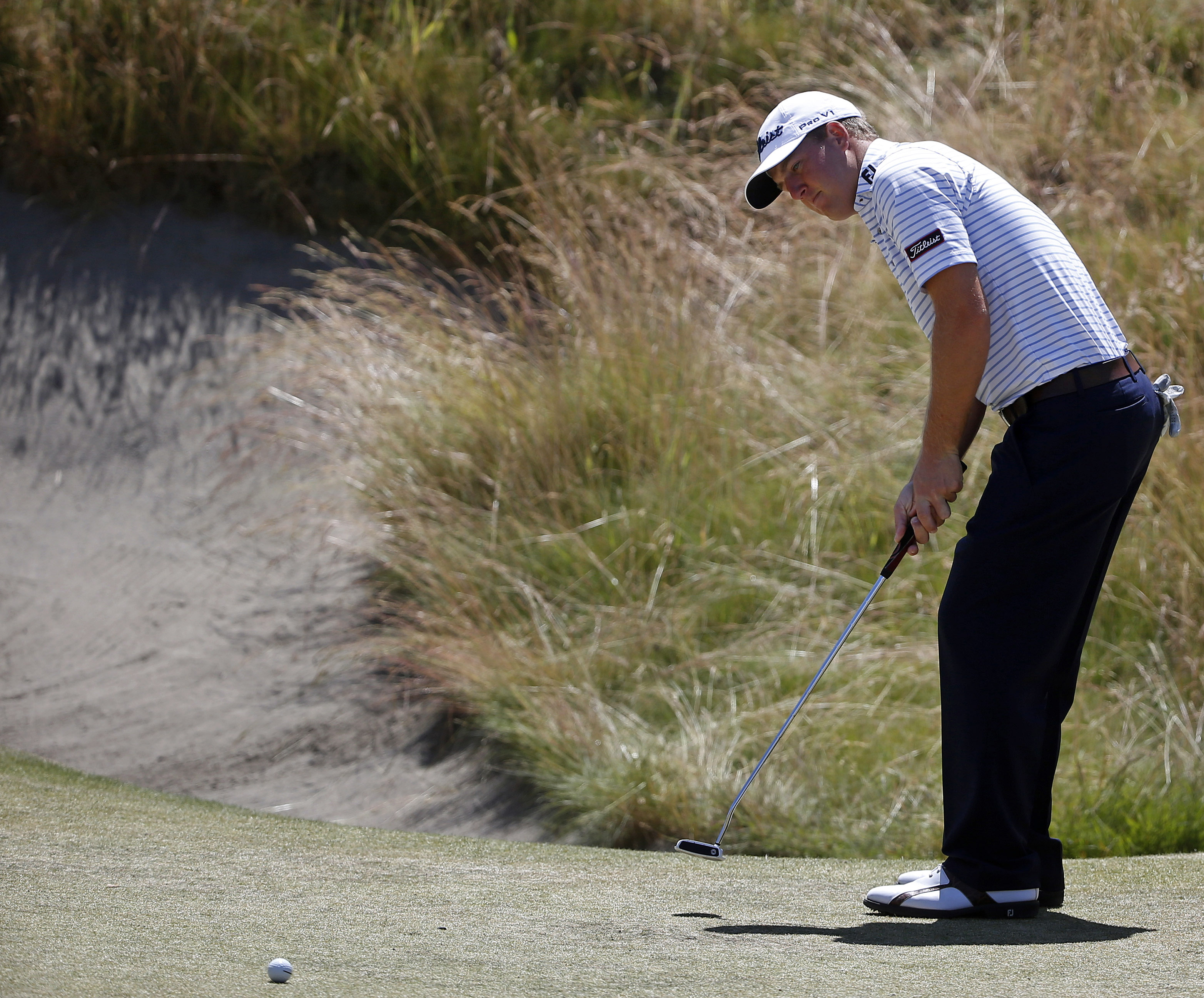 Tom Hoge putts on the 10th hole during a practice round for the U.S. Open golf tournament at Chambers Bay on Wednesday, June 17, 2015 in University Place, Wash. (AP Photo/Lenny Ignelzi)