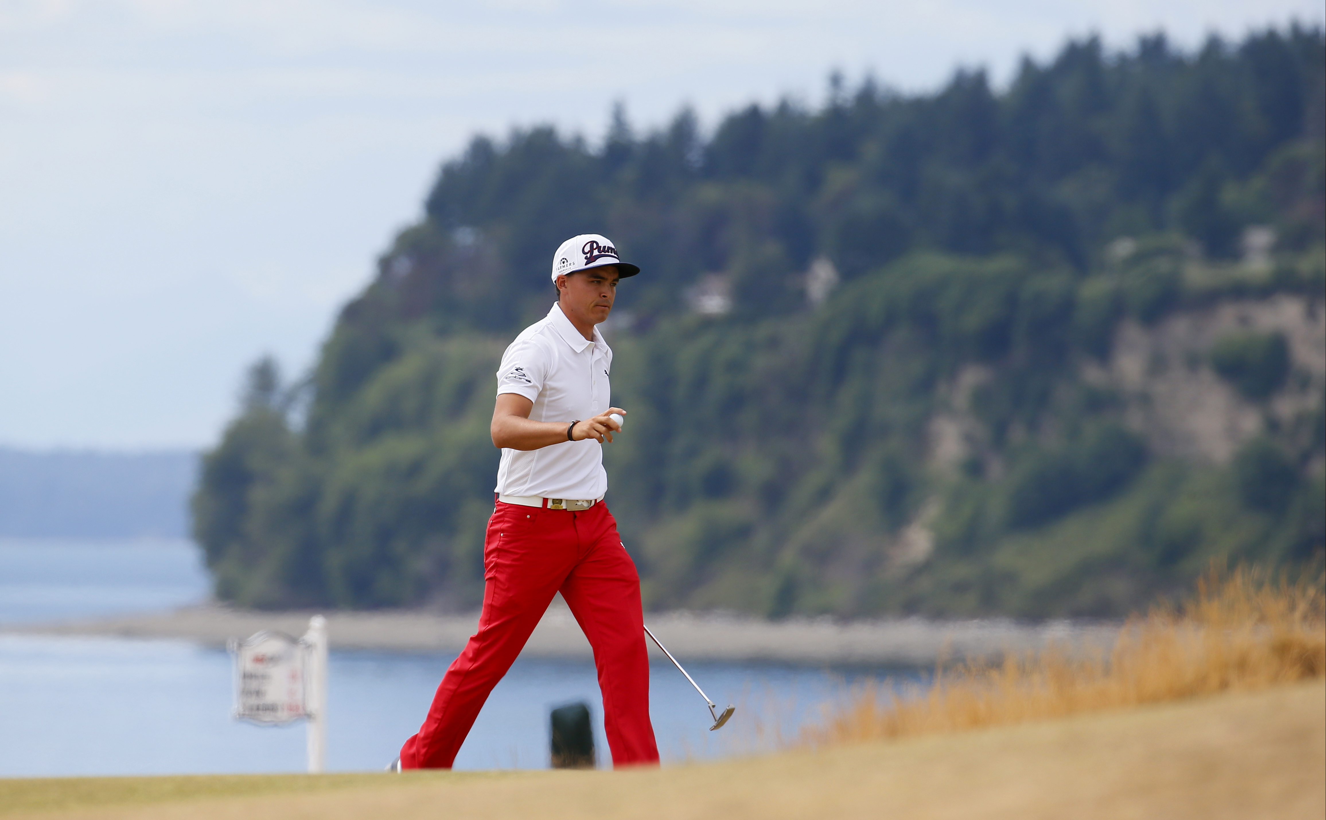 Rickie Fowler reacts to his putt on the third hole during the first round of the U.S. Open golf tournament at Chambers Bay on Thursday, June 18, 2015 in University Place, Wash. (AP Photo/Matt York)