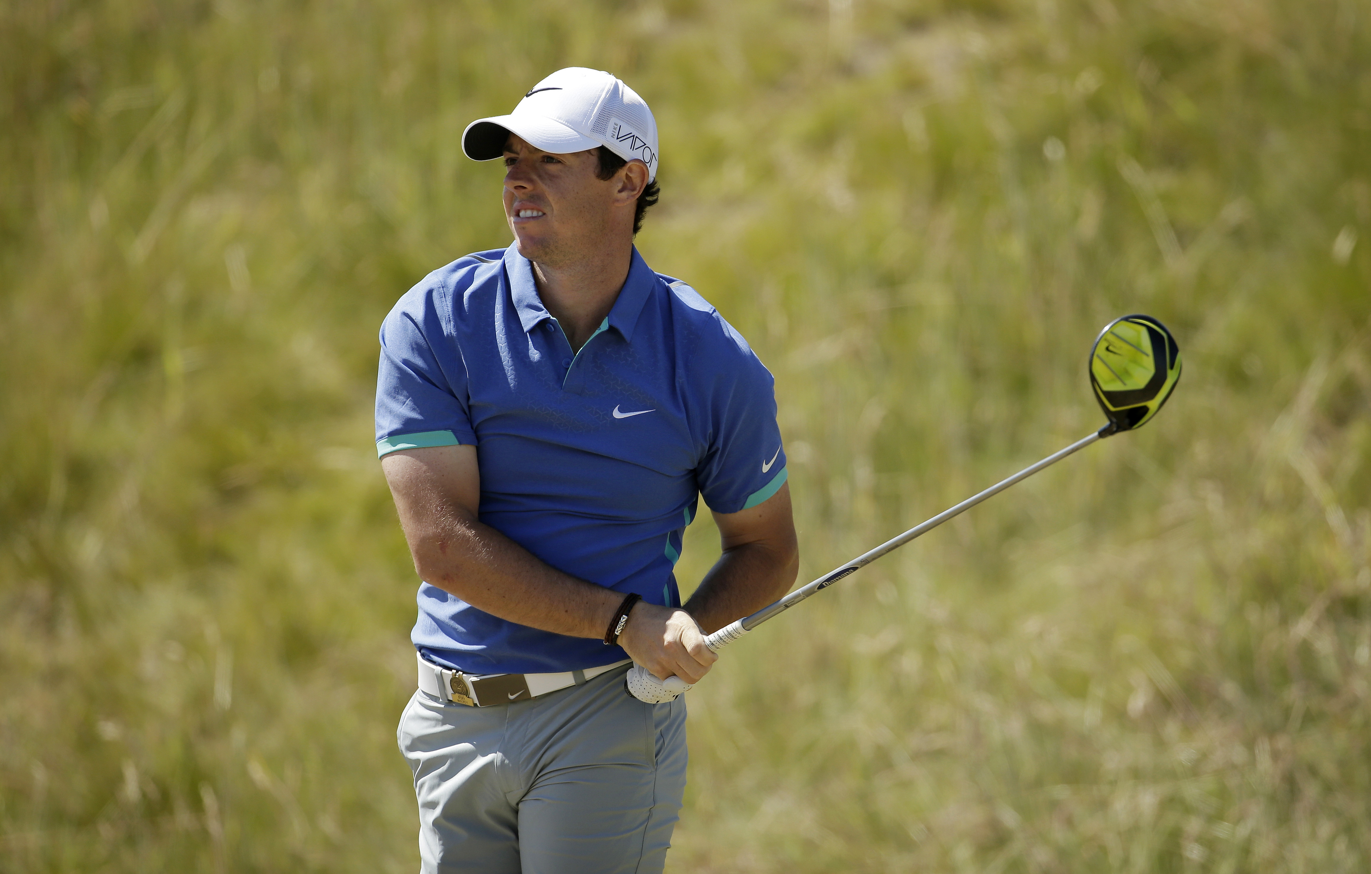Rory McIlroy, of Northern Ireland, watches his tee shot on the seventh hole during the third round of the U.S. Open golf tournament at Chambers Bay on Saturday, June 20, 2015 in University Place, Wash. (AP Photo/Charlie Riedel)