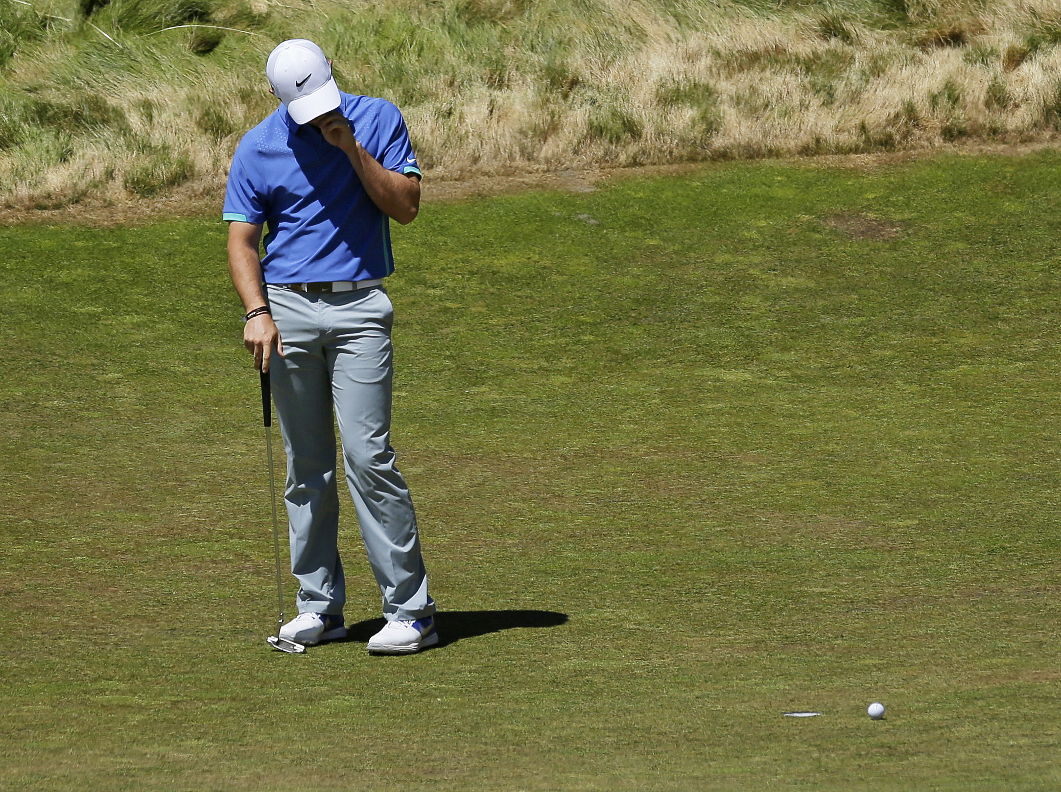 Rory McIlroy, of Northern Ireland, reacts after missing a putt on the 12th hole during the third round of the U.S. Open golf tournament at Chambers Bay on Saturday, June 20, 2015 in University Place, Wash. (AP Photo/Ted S. Warren)