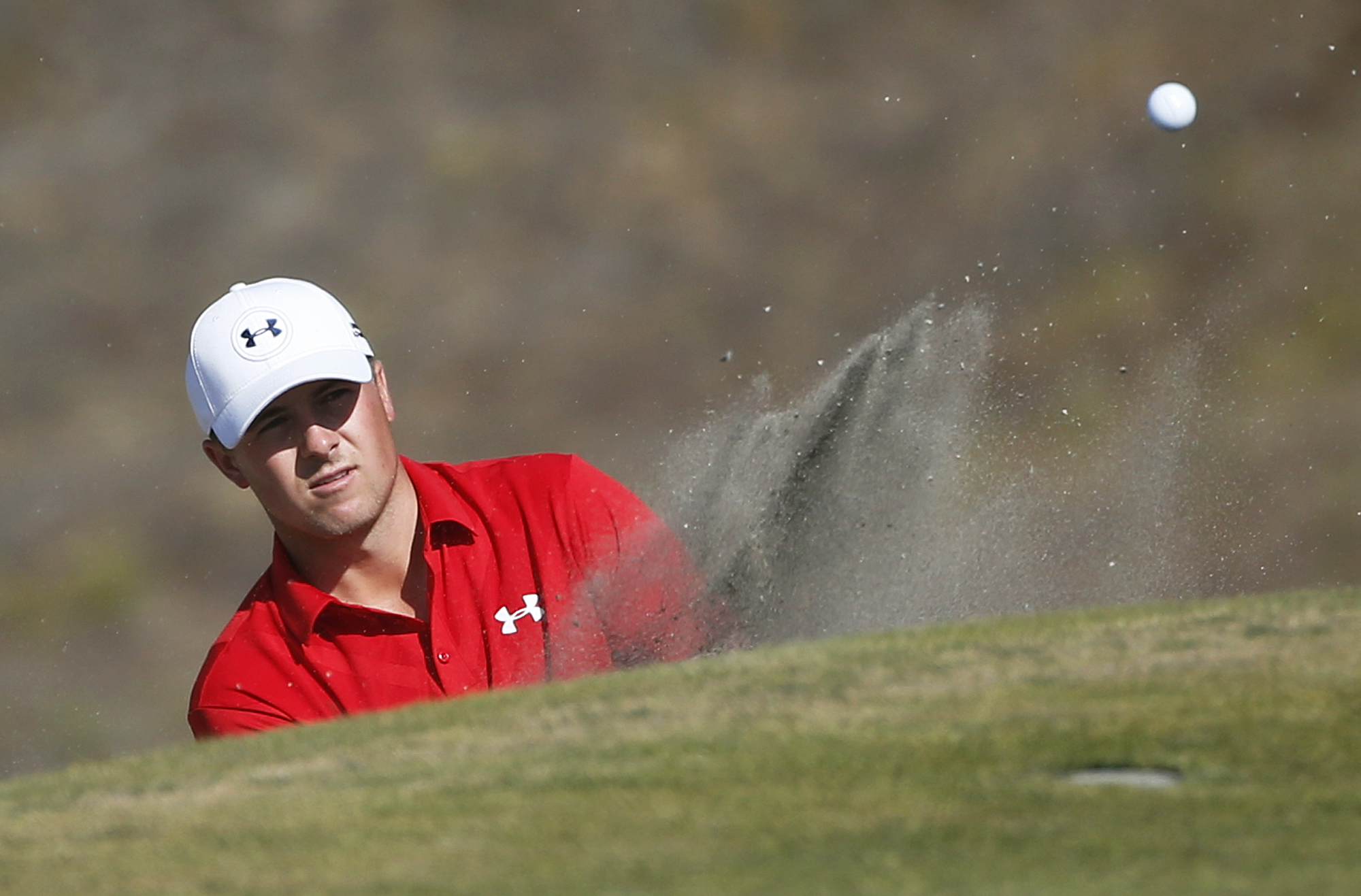 Jordan Spieth hits out of the bunker on the ninth hole during the third round of the U.S. Open golf tournament at Chambers Bay on Saturday, June 20, 2015 in University Place, Wash. (AP Photo/Lenny Ignelzi)