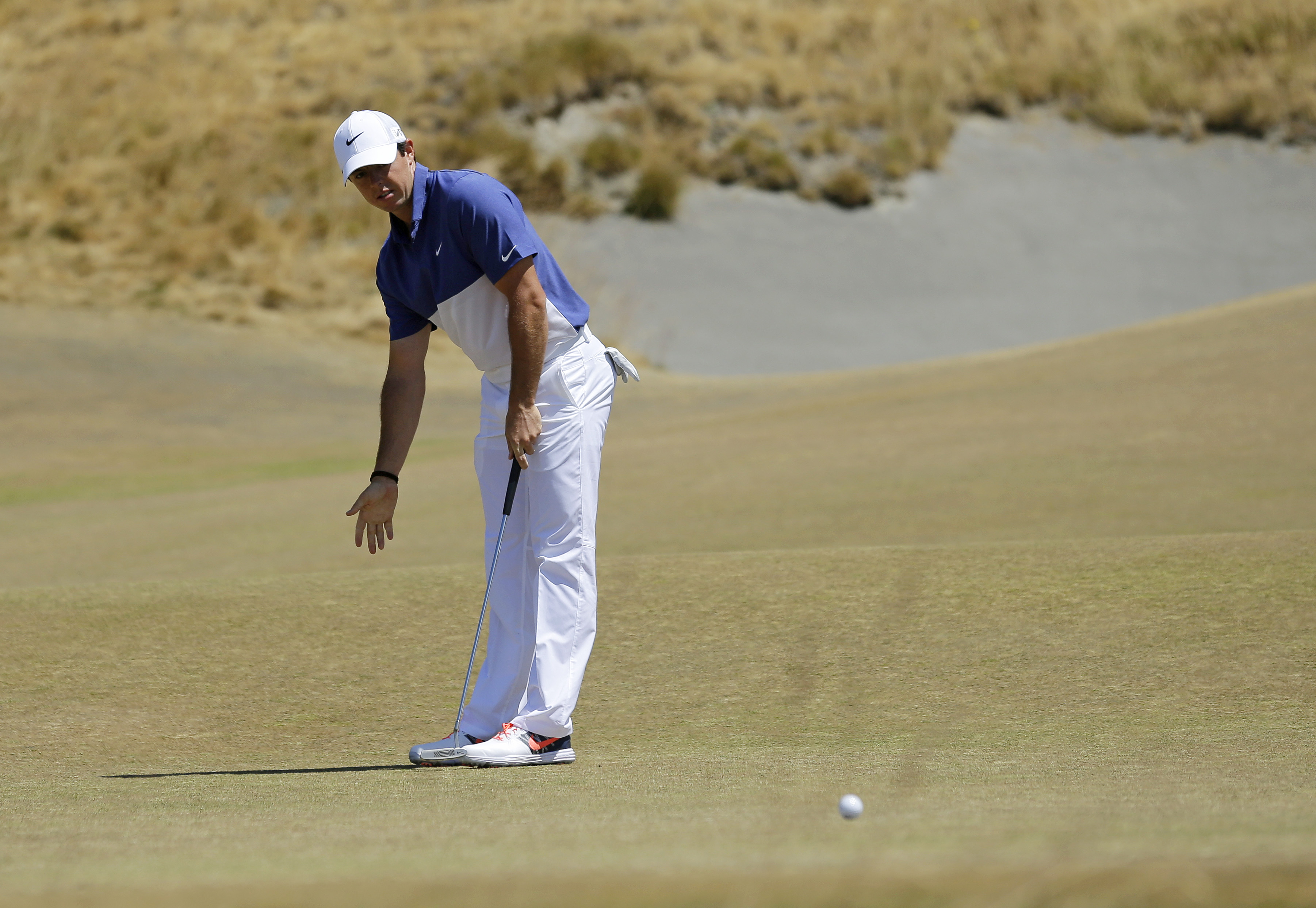 Rory McIlroy, of Northern Ireland, reacts to his putt on the fourth hole during the final round of the U.S. Open golf tournament at Chambers Bay on Sunday, June 21, 2015 in University Place, Wash. (AP Photo/Ted S. Warren)