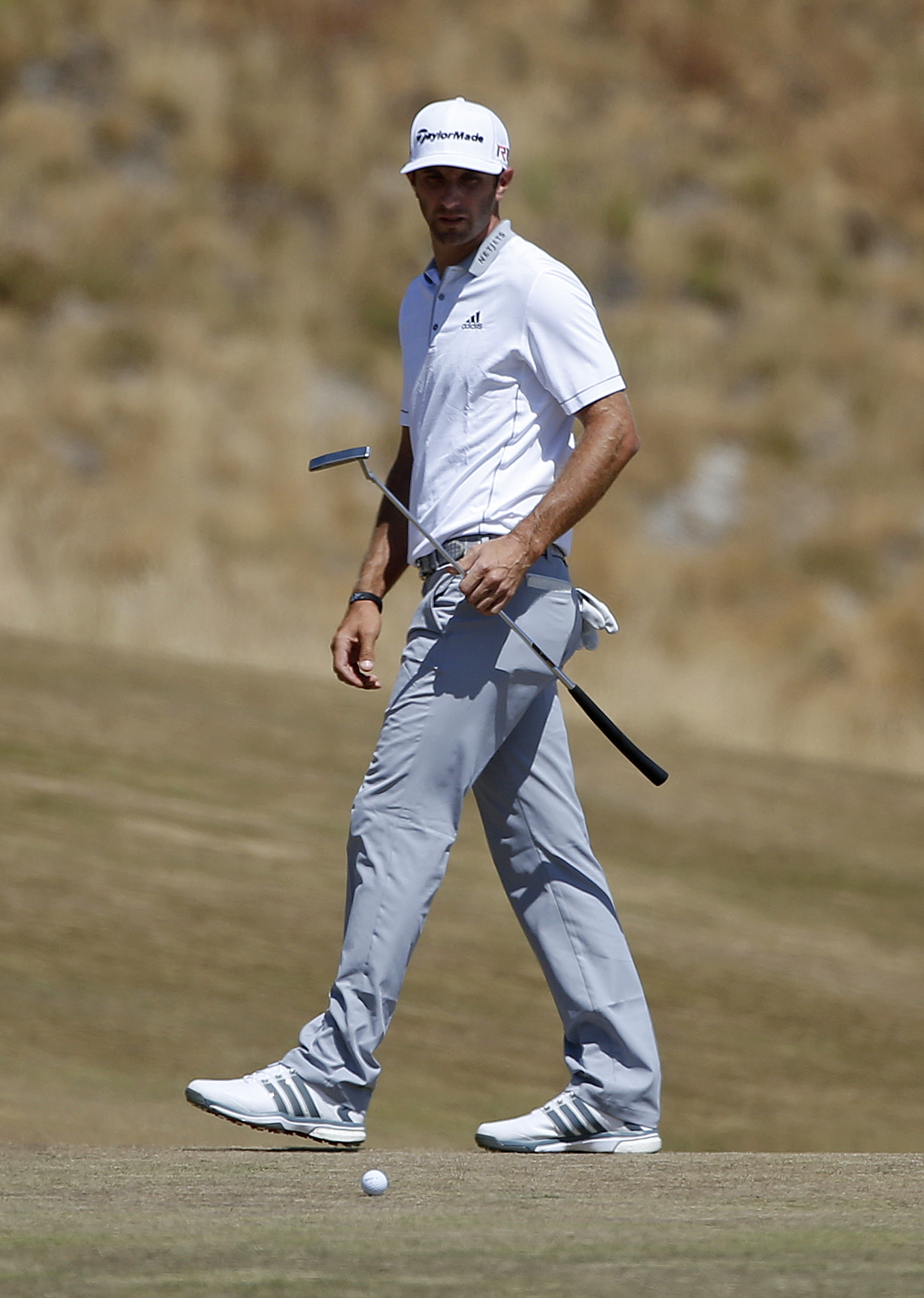 Dustin Johnson watches his putt on the first hole during the final round of the U.S. Open golf tournament at Chambers Bay on Sunday, June 21, 2015 in University Place, Wash. (AP Photo/Lenny Ignelzi)