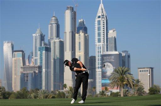 Andrew Johnston of England plays a ball on the 13th hole during the round one of the Dubai Desert Classic golf tournament in Dubai, United Arab Emirates, Thursday, Jan. 29, 2015. (AP Photo/Kamran Jebreili)