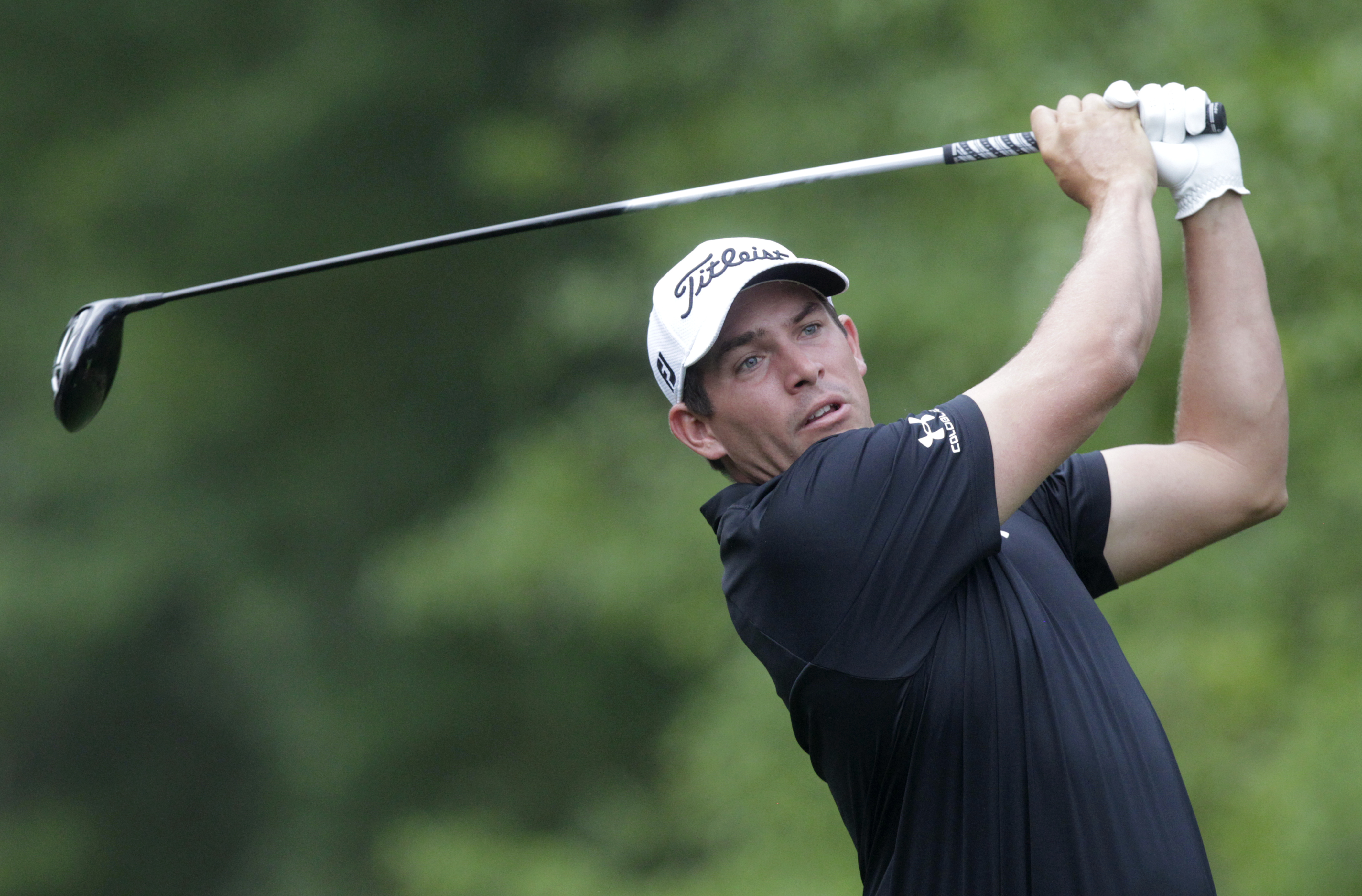 Scott Stallings watches his tee shot on the second hole at the Houston Open golf tournament in Humble, Texas, Thursday, April 2, 2015. (AP Photo/Patric Schneider)
