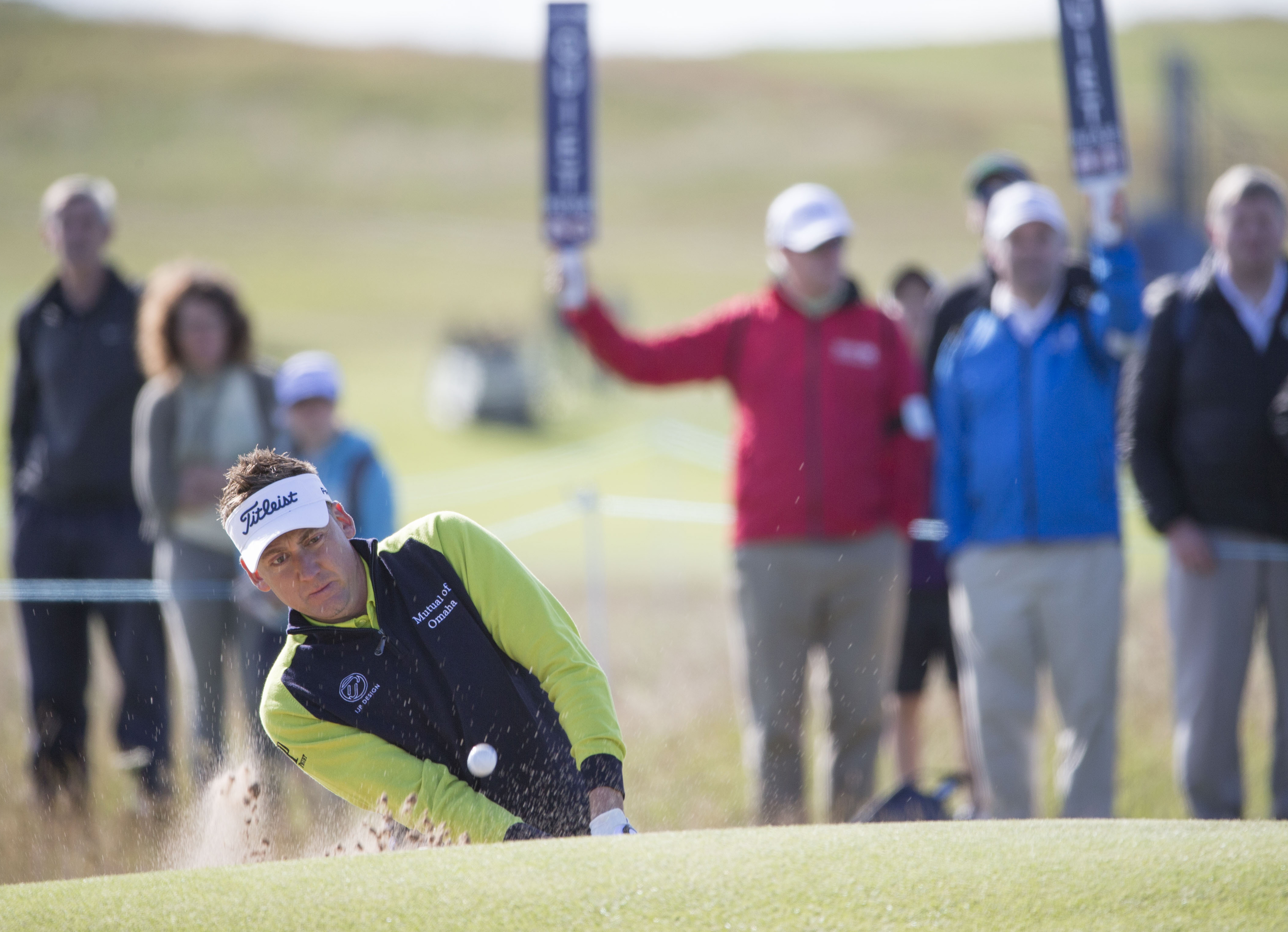 England's Ian Poulter plays from the green side bunker on the 2nd hole during day one of the Scottish Open at Gullane Golf Club, in Gullane Scotland Thursday July 9, 2015. (Kenny Smith/PA via AP) UNITED KINGDOM OUT  NO SALES NO ARCHIVE
