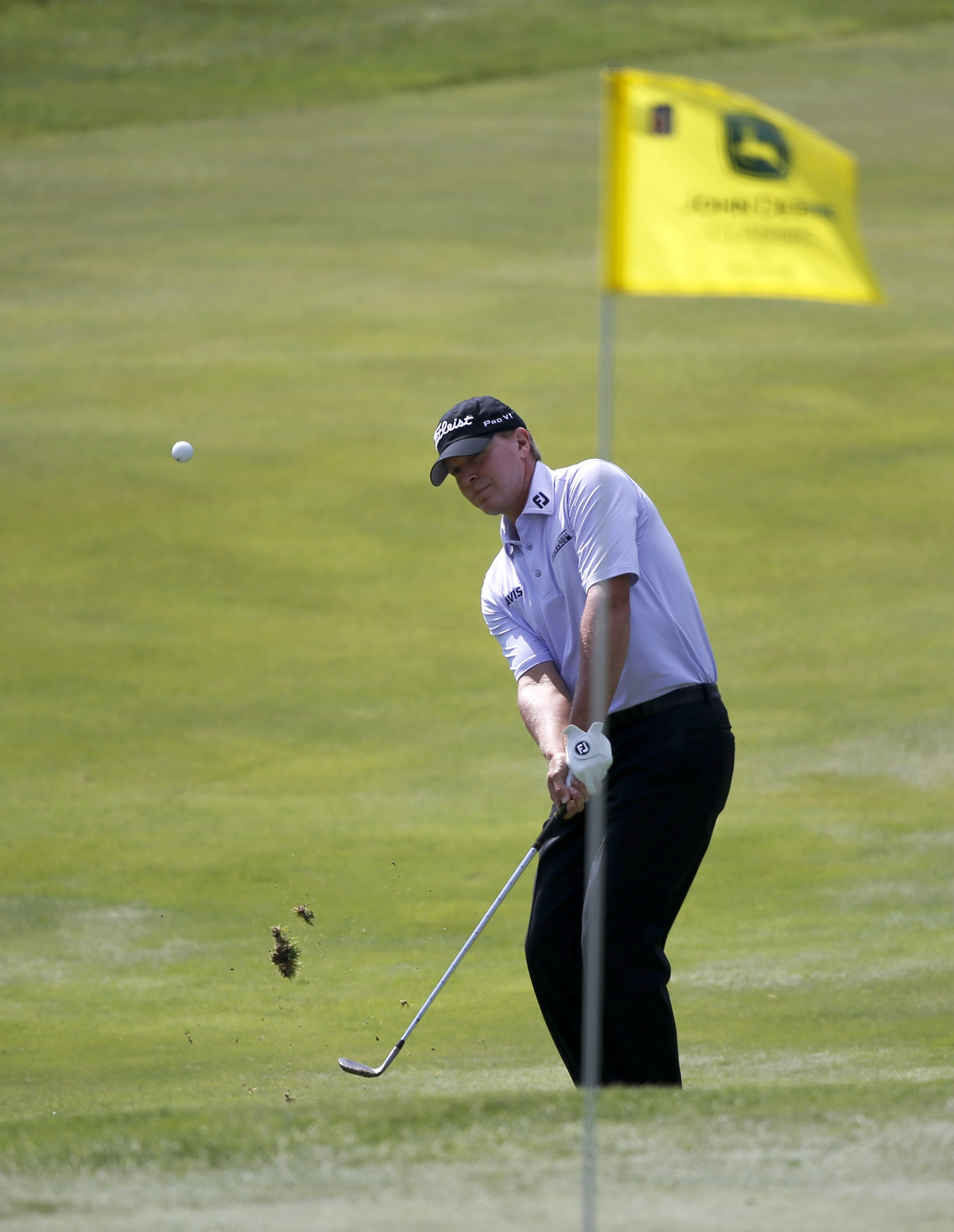 Golfer Steve Stricker chips onto the 17th green during the first round of the John Deere Classic golf tournament Thursday, July 9, 2015, in Silvis , Ill. (AP Photo/Charles Rex Arbogast)