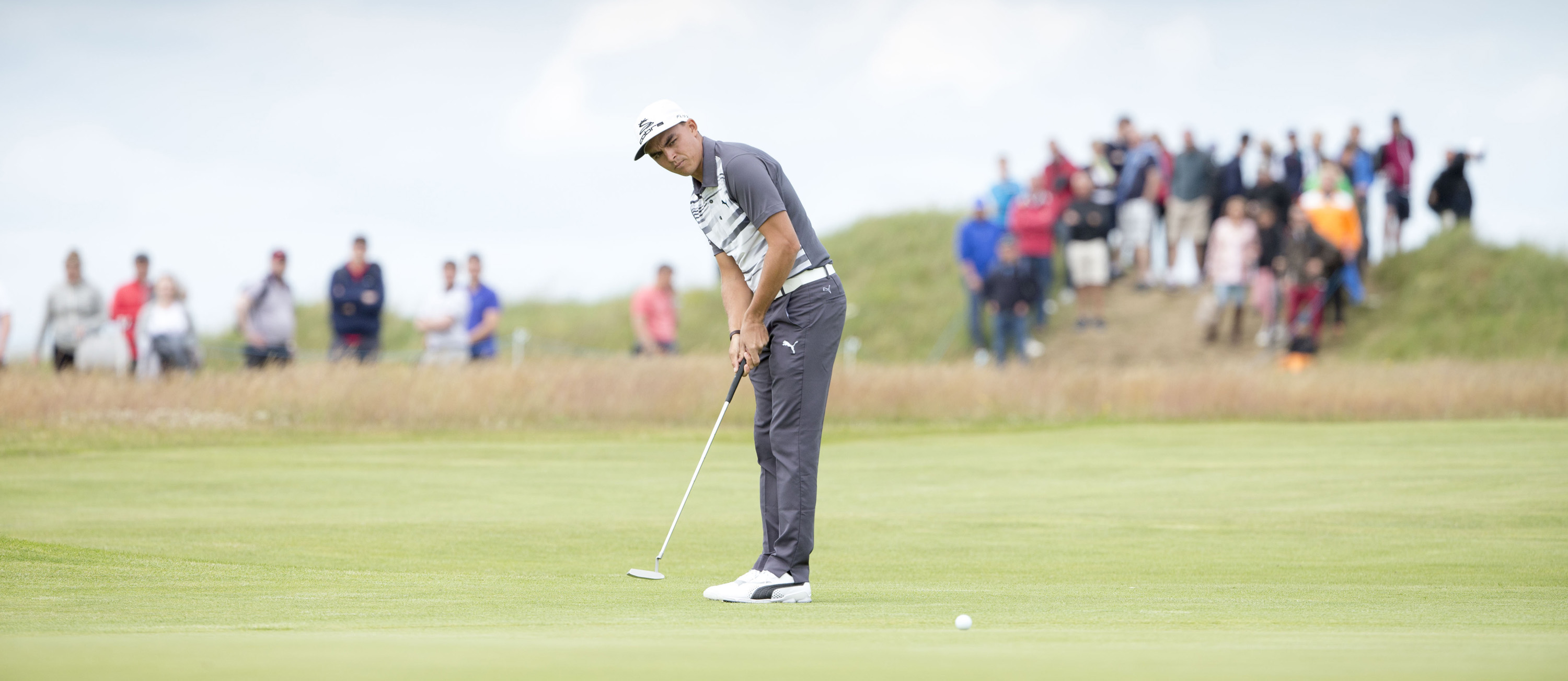 USA's Rickie Fowler putts out at the 9th hole during day three of the Scottish Open at Gullane Golf Club, Gullane, Scotland  Saturday July 11, 2015.  (Kenny Smith/PA via AP) UNITED KINGDOM OUT  NO SALES NO ARCHIVE