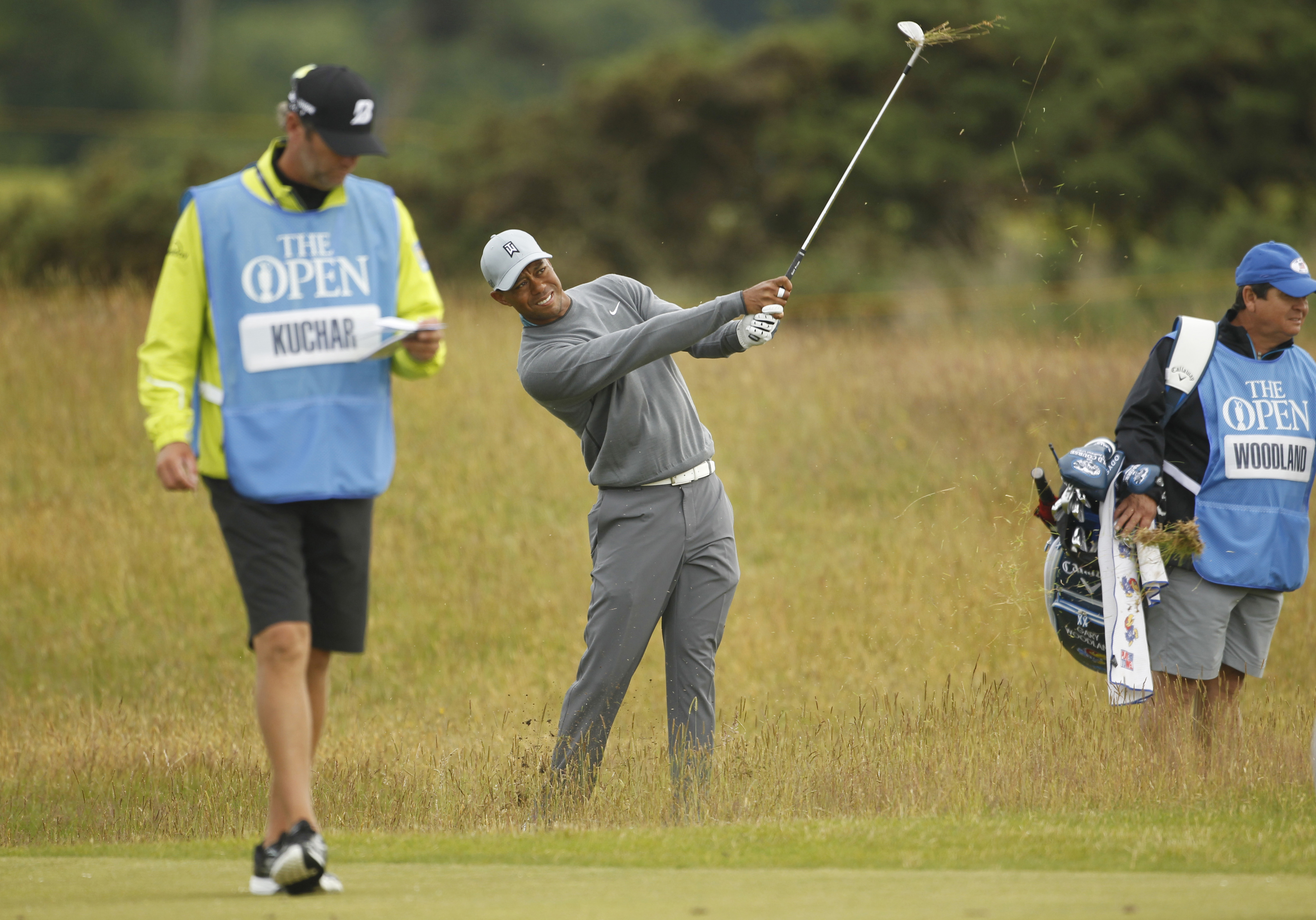 Tiger Woods from the U.S. plays from the rough on the 7th hole during a practice round at St. Andrews Golf Club prior to the start of the British Open Golf Championship, in St. Andrews, Scotland, Monday, July 13, 2015. (AP Photo/Peter Morrison)