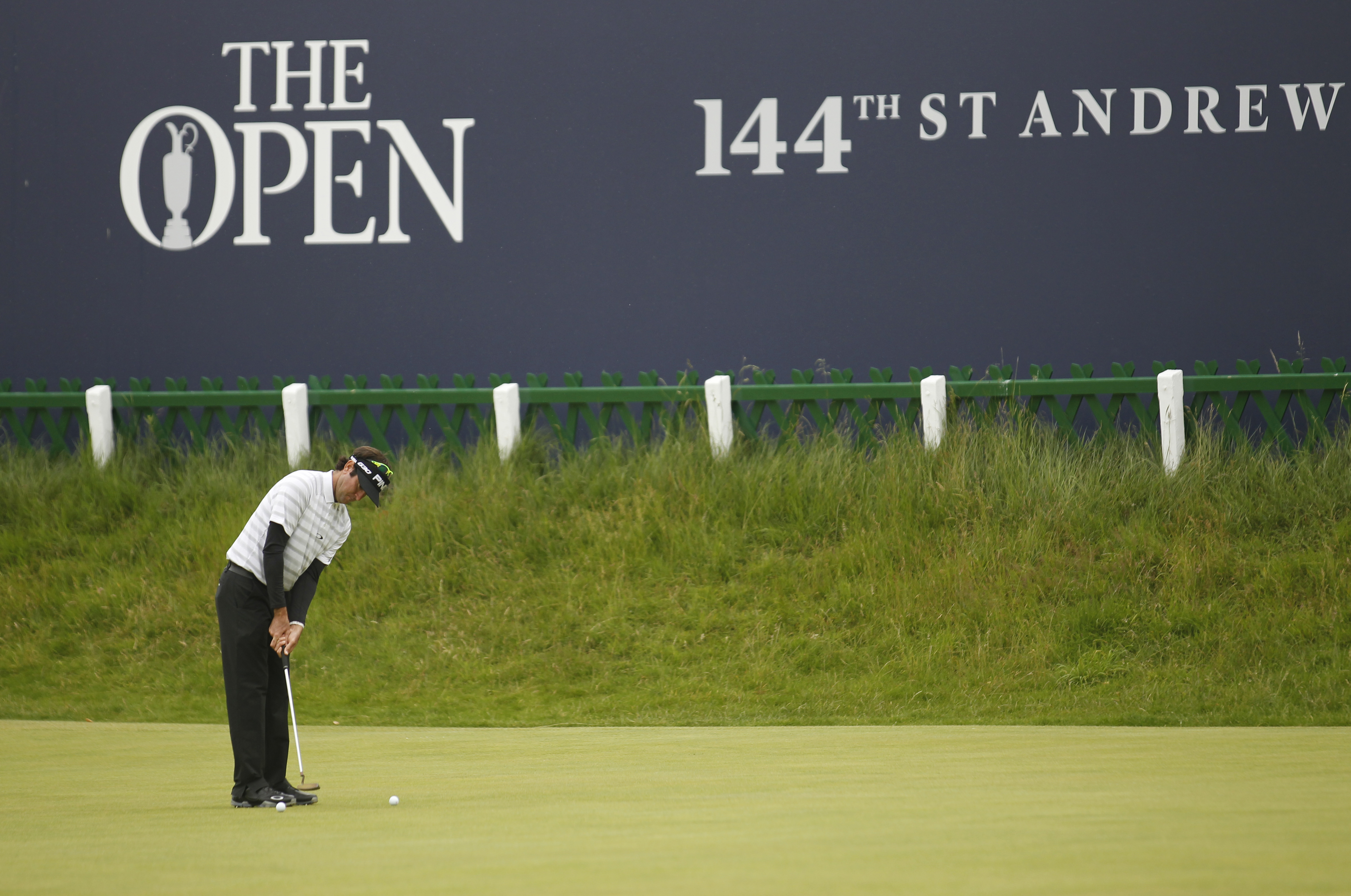 Bubba Watson from the U.S putts on the 18th green during a practice round at St. Andrews Golf Club prior to the start of the British Open Golf Championship, in St. Andrews, Scotland, Monday, July 13, 2015. (AP Photo/Peter Morrison)