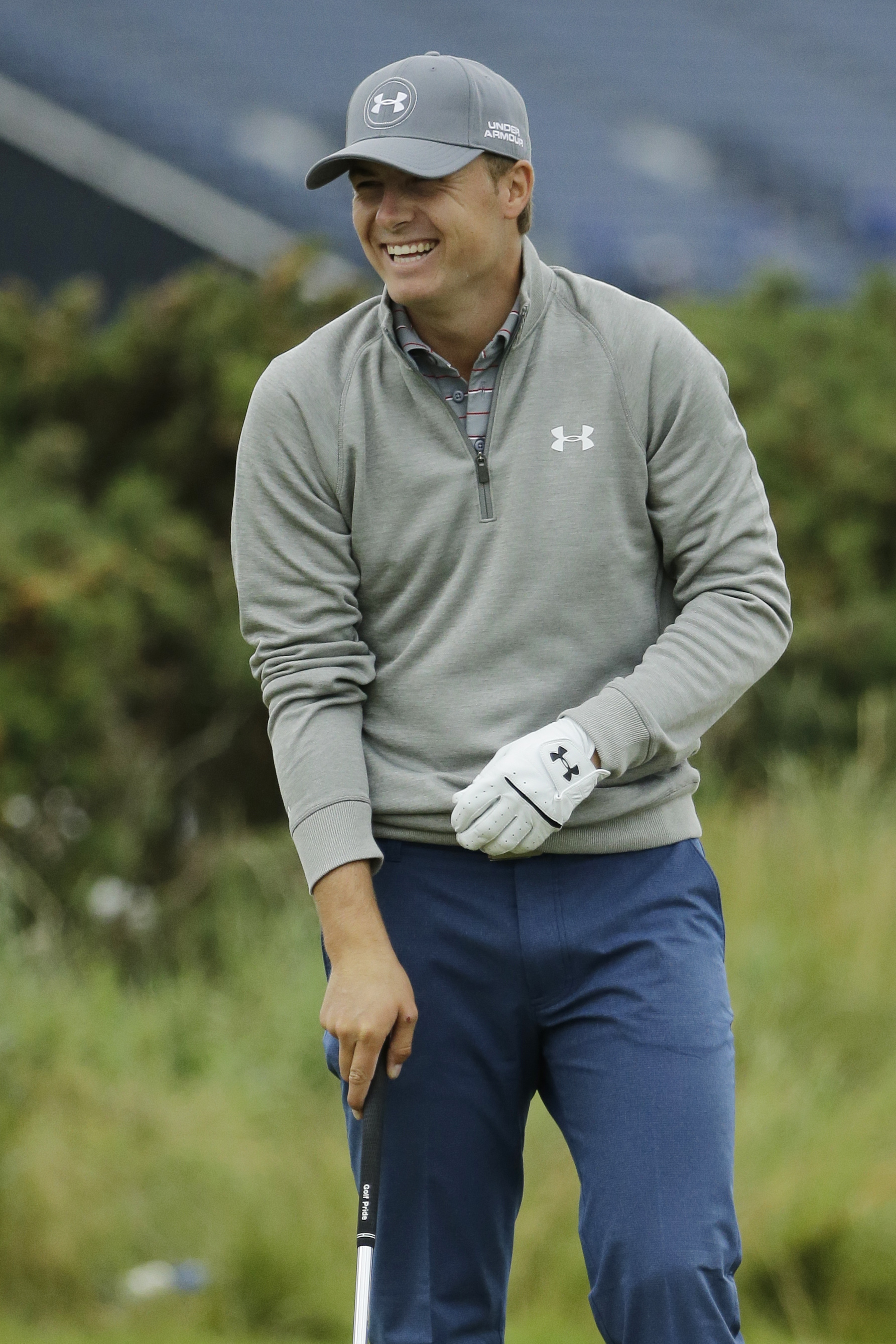 United States' Jordan Spieth laughs on the putting green during a practice round at the British Open Golf Championship at the Old Course, St. Andrews, Scotland, Tuesday, July 14, 2015. (AP Photo/David J. Phillip)