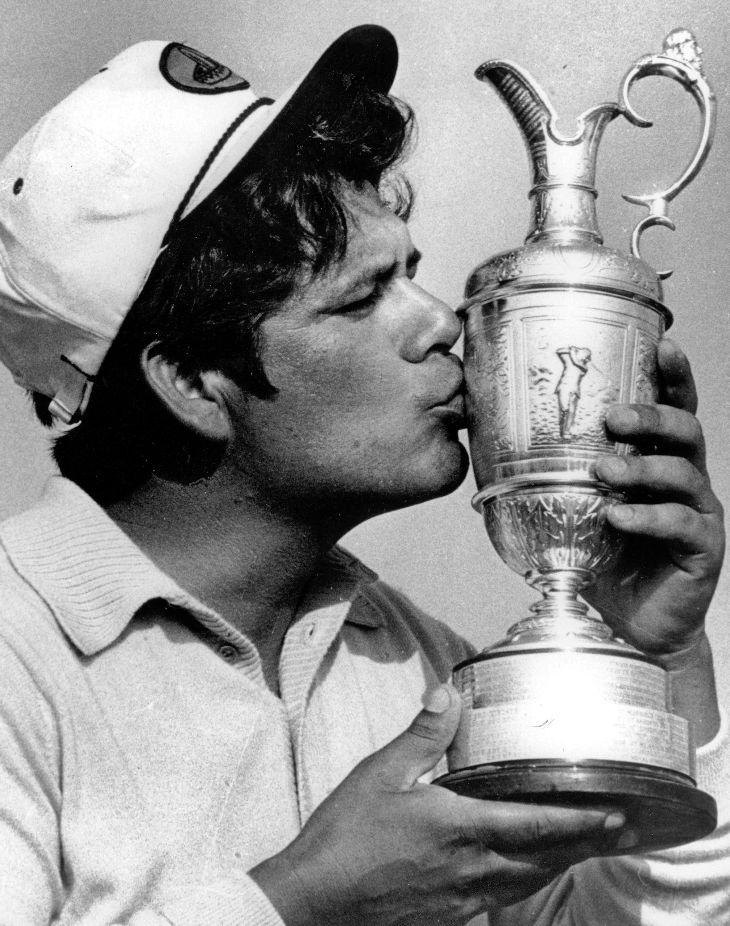FILE - In this Saturday, July 15, 1972 file photo, Lee Trevino kisses the British Open Golf Championship cup after he won the title for the second year running in Muirfield, Scotland. Trevino's triumph shattered Jack Nicklaus' dream of a one-year sweep of