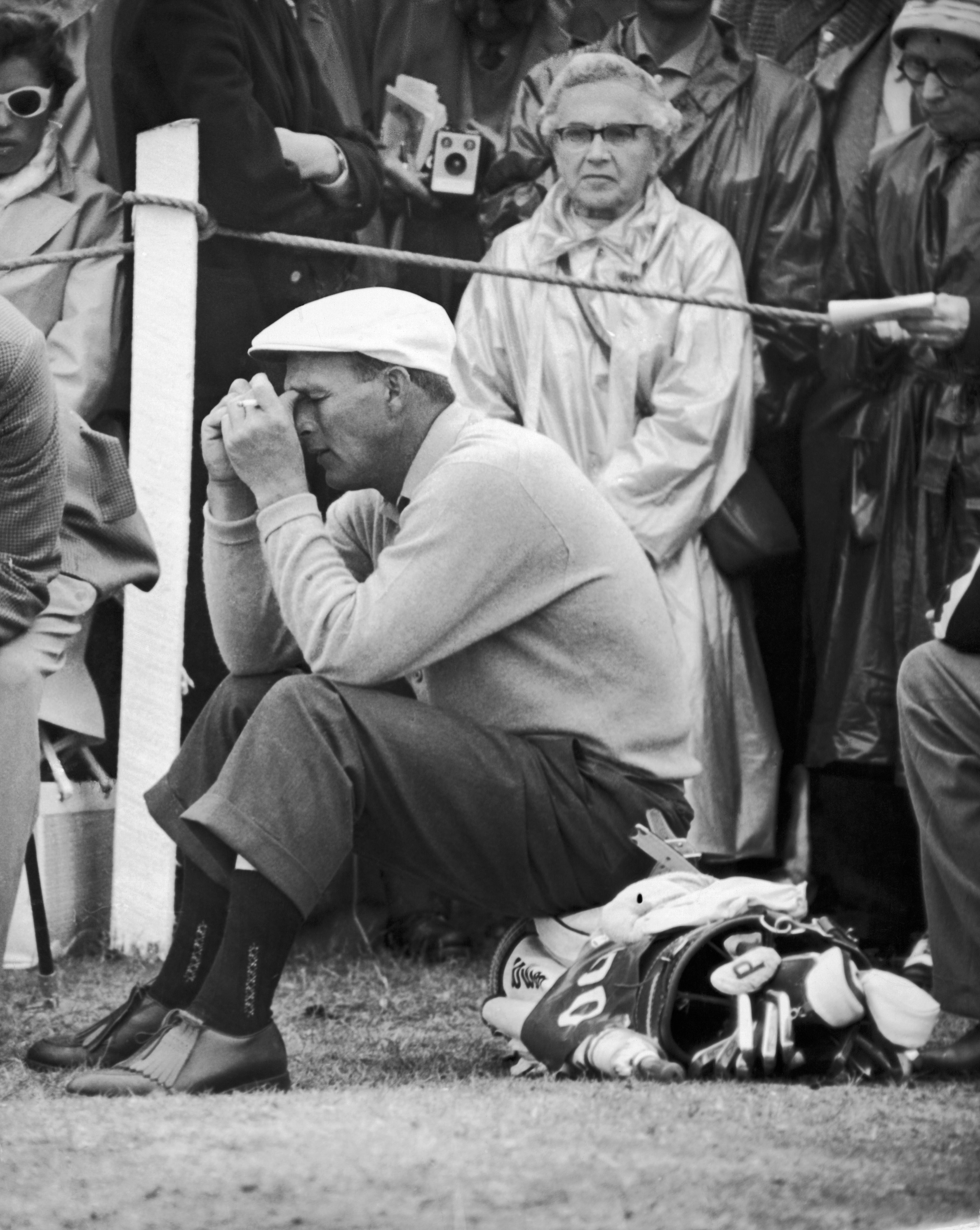 FILE - In this July 5, 1960 file photo, Arnold Palmer, U.S. Open Champion, sits on his golf bag and relaxes halfway through his troublesome second round of qualifying play in the British Open Championship at St. Andrews, Scotland. At that point, the 10th