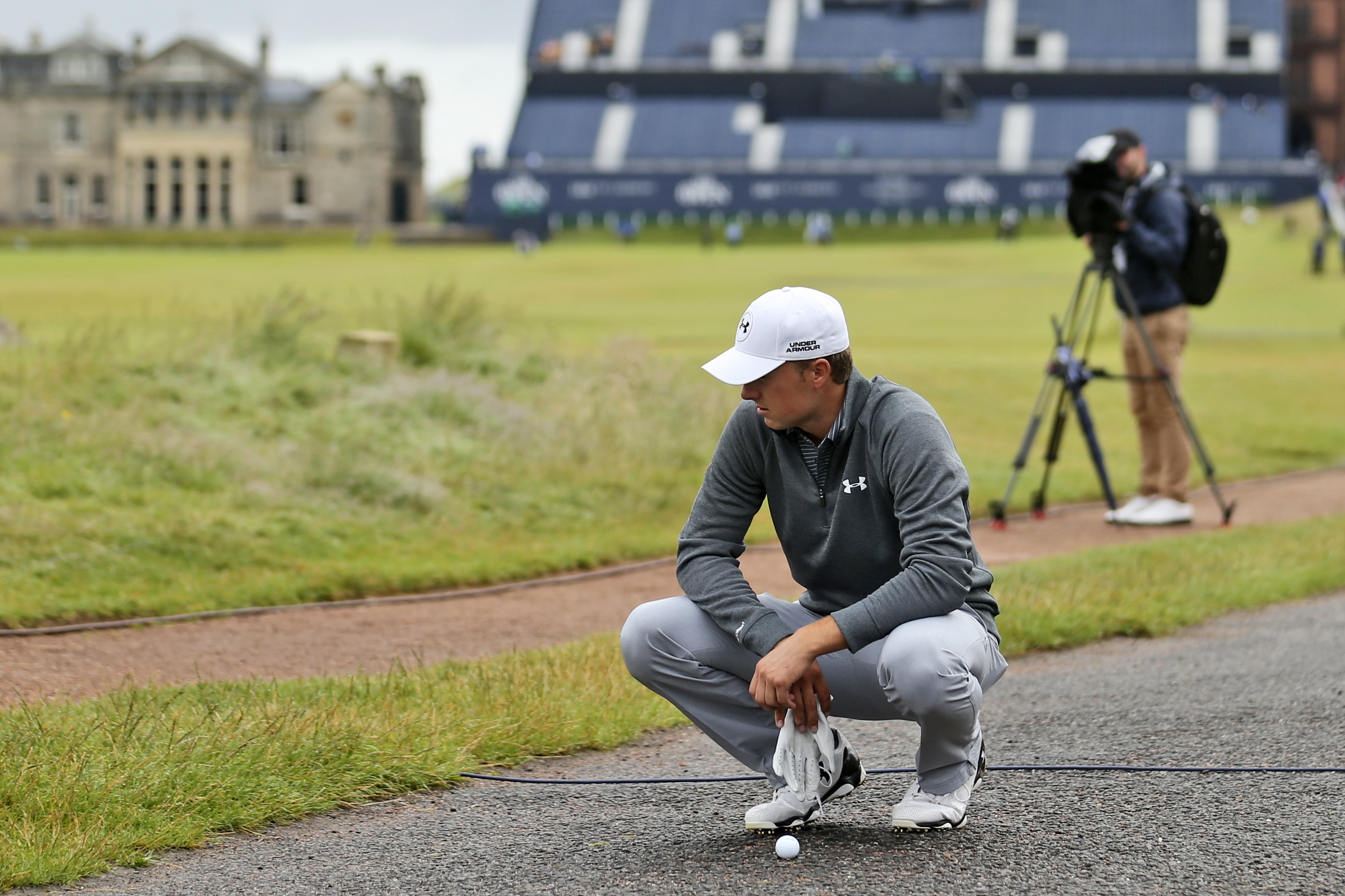 United States' Jordan Spieth looks at his ball on a path behind the 17th green during a practice round at the British Open Golf Championship at the Old Course, St. Andrews, Scotland, Wednesday, July 15, 2015. (AP Photo/Peter Morrison)