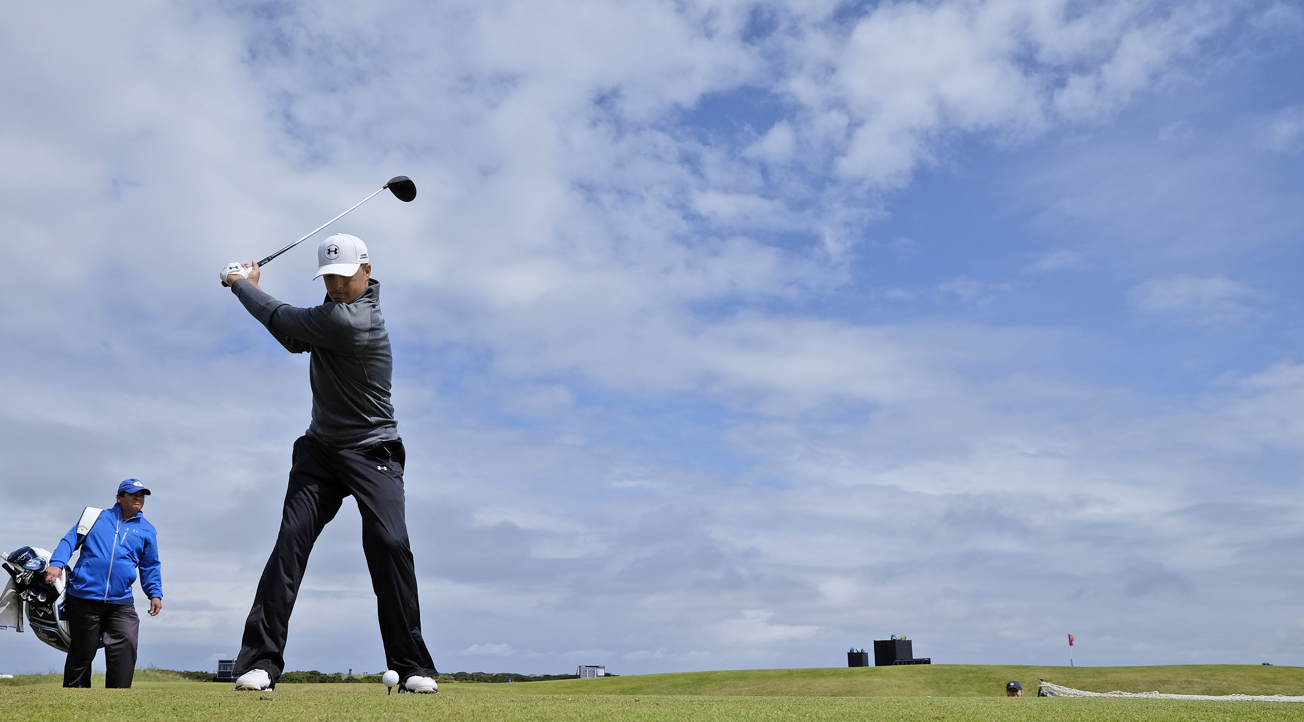 United States' Jordan Spieth drives a ball from the 12th tee during a practice round at the British Open Golf Championship at the Old Course, St. Andrews, Scotland, Wednesday, July 15, 2015. (AP Photo/David J. Phillip)