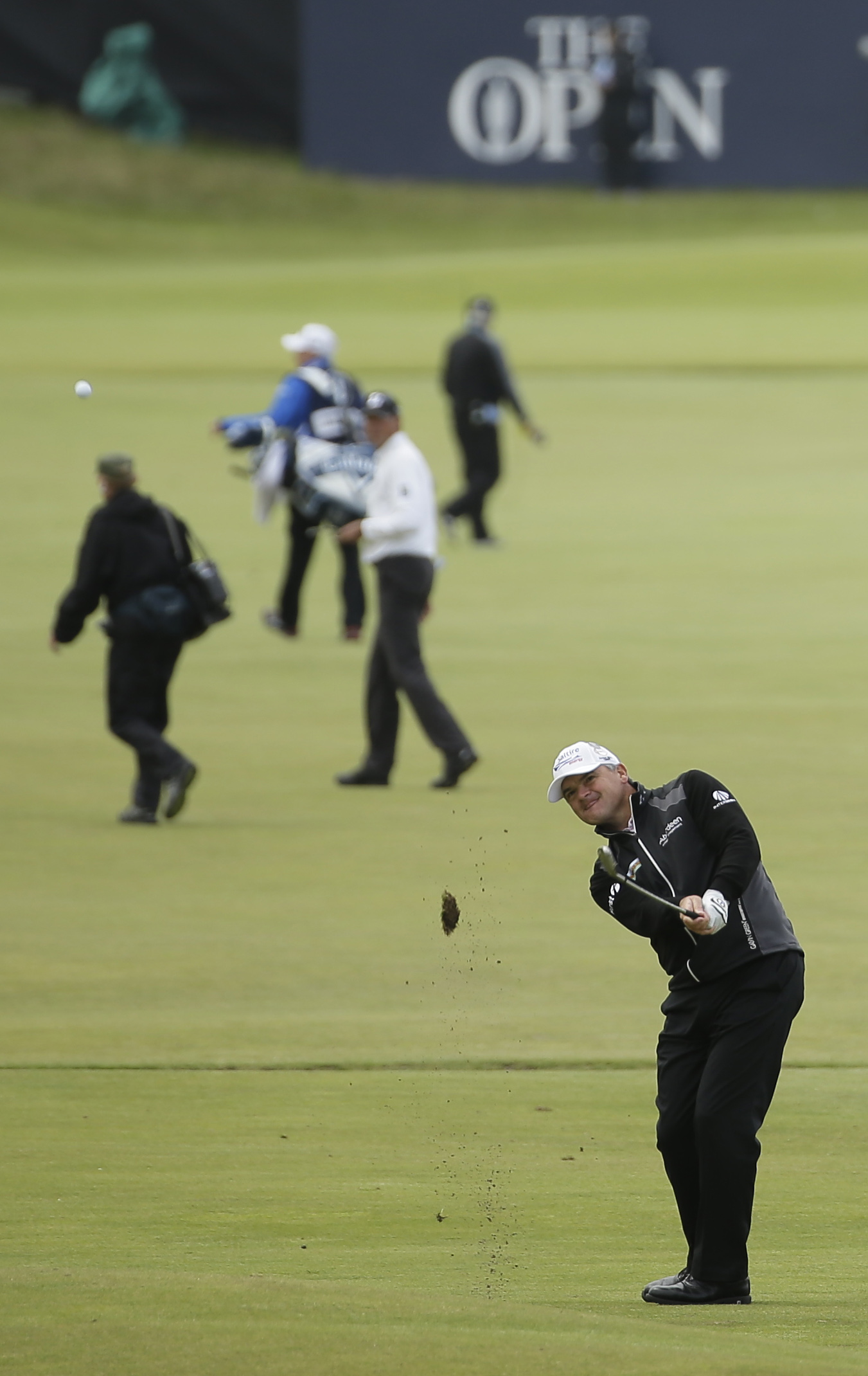 Scotland Paul Lawrie plays a shot on the 18th hole during the first round of the British Open Golf Championship at the Old Course, St. Andrews, Scotland, Thursday, July 16, 2015. (AP Photo/David J. Phillip)