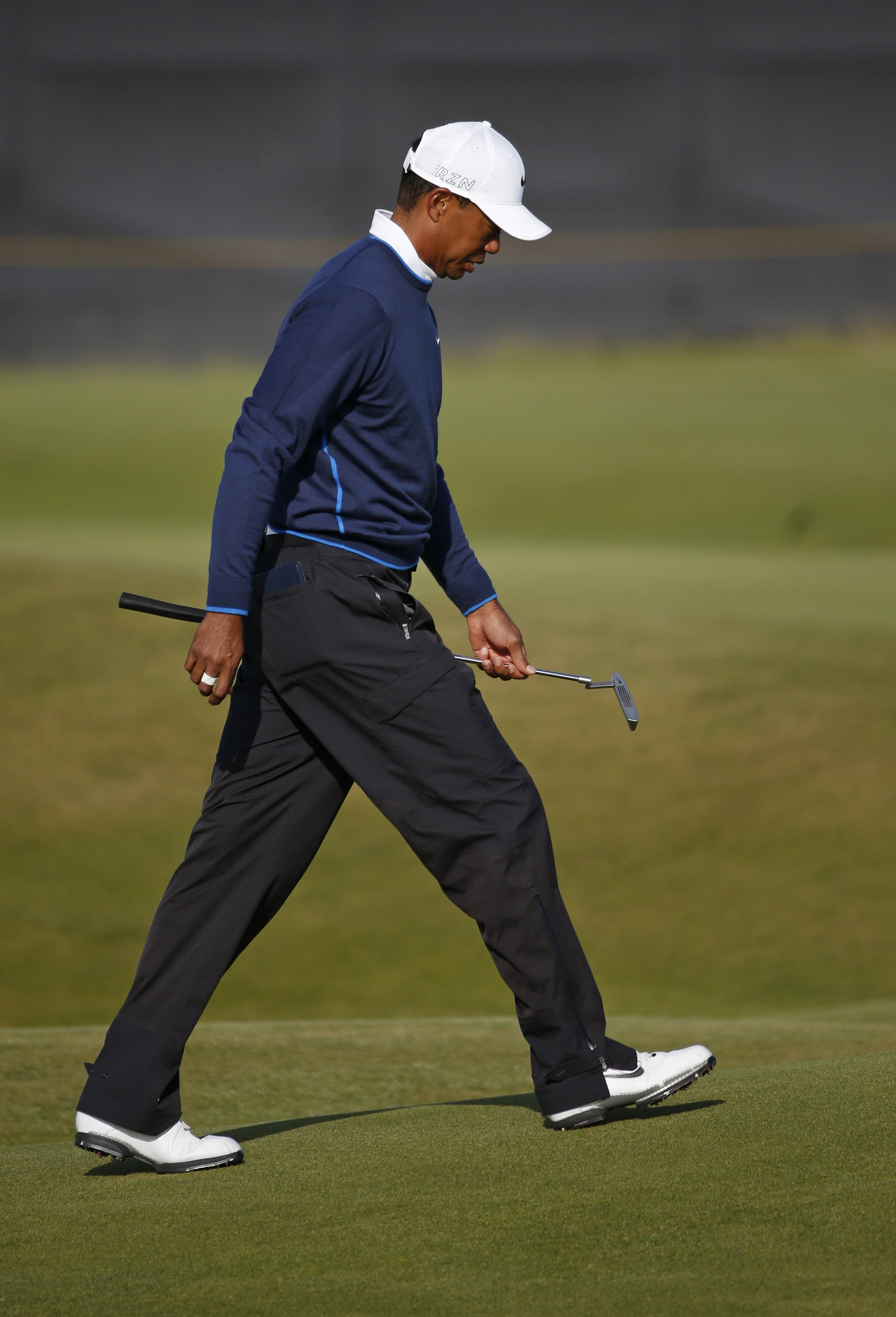 United States' Tiger Woods walks on the 14th hole during the second round of the British Open Golf Championship at the Old Course, St. Andrews, Scotland, Saturday, July 18, 2015. (AP Photo/Jon Super)