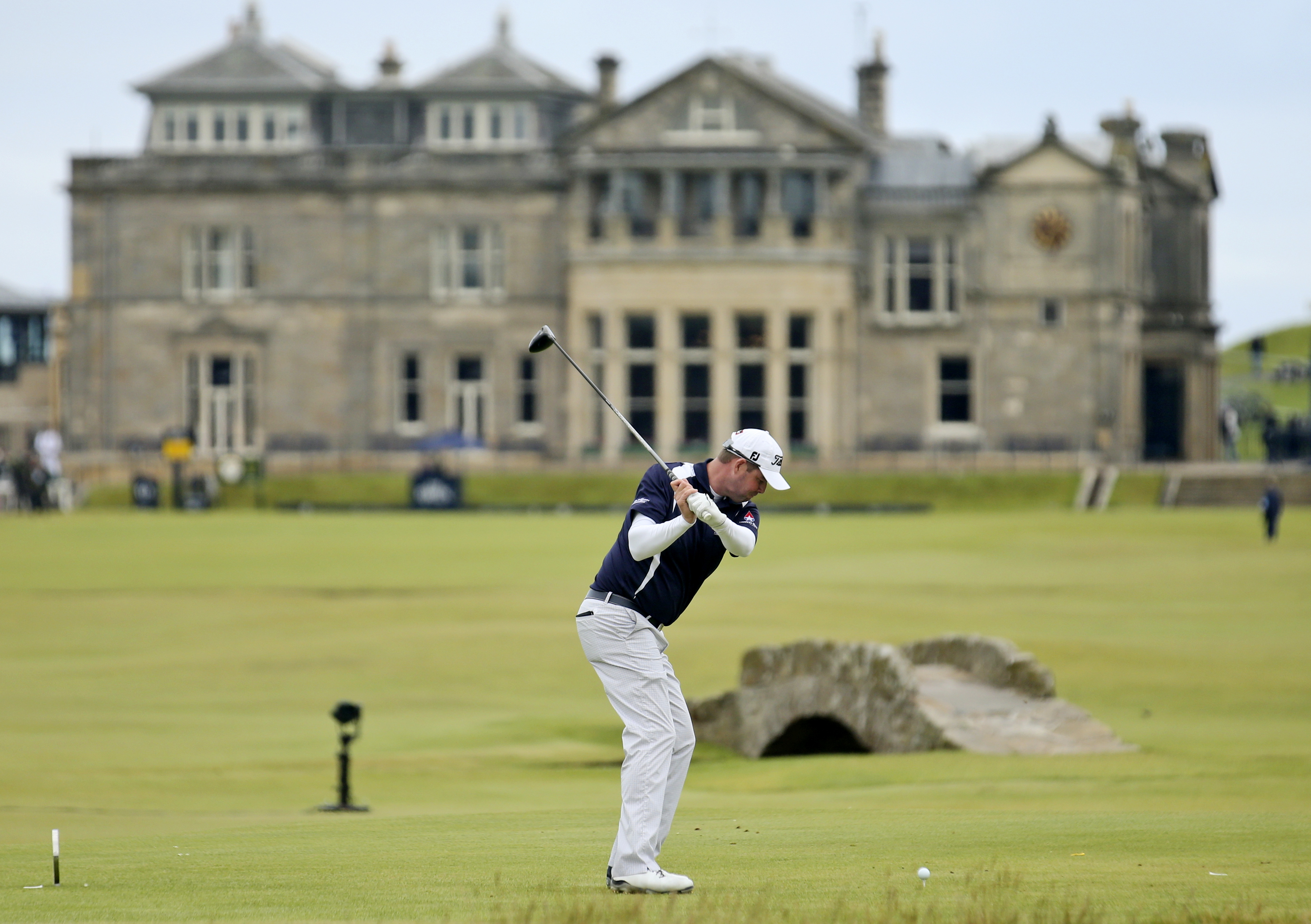 Australia's Marc Leishman plays from the 18th tee during the third round at the British Open Golf Championship at the Old Course, St. Andrews, Scotland, Sunday, July 19, 2015. (AP Photo/Peter Morrison)