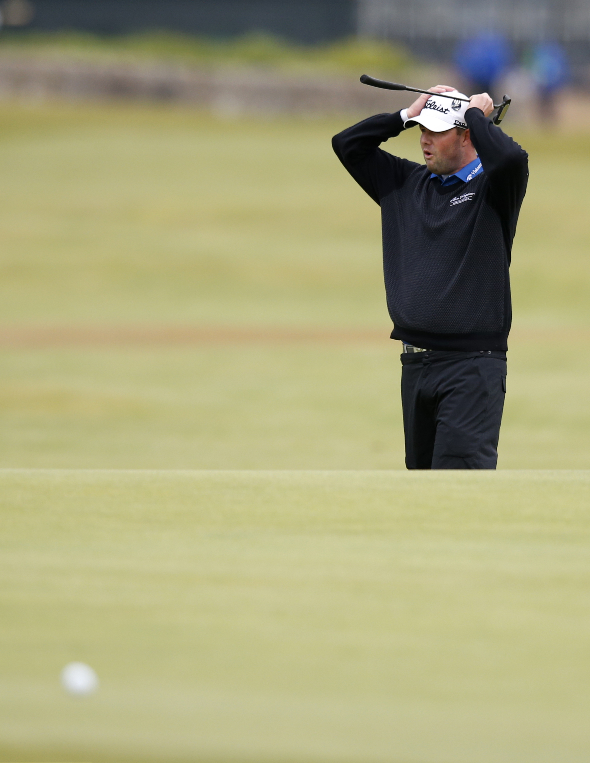 Australia's Marc Leishman reacts after missing a putt on the 17th during the final round at the British Open Golf Championship at the Old Course, St. Andrews, Scotland, Monday, July 20, 2015. (AP Photo/Jon Super)