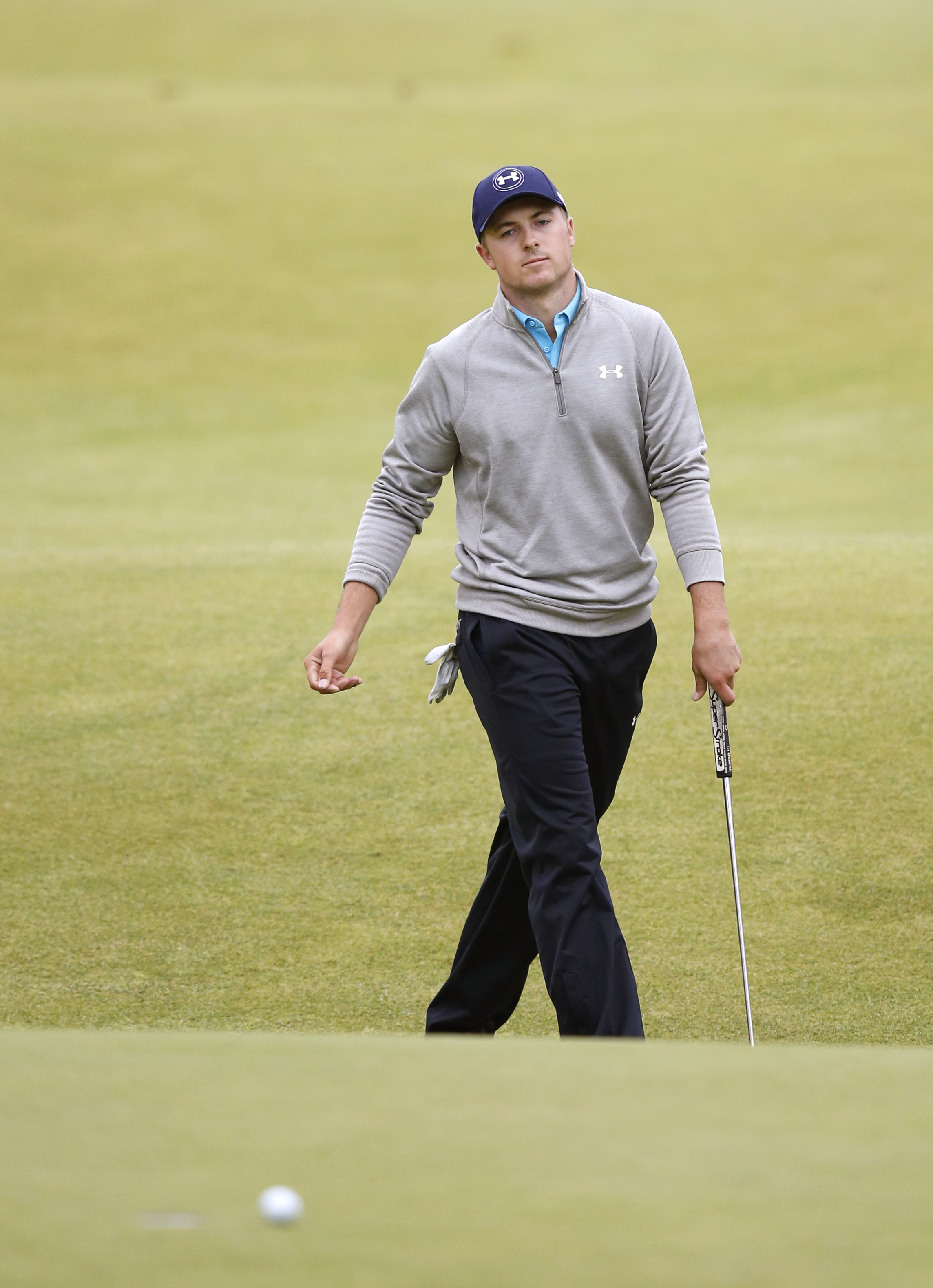 United States' Jordan Spieth reacts after missing a putt on the 18th green in the final round at the British Open Golf Championship at the Old Course, St. Andrews, Scotland, Monday, July 20, 2015.  (AP Photo/Jon Super)