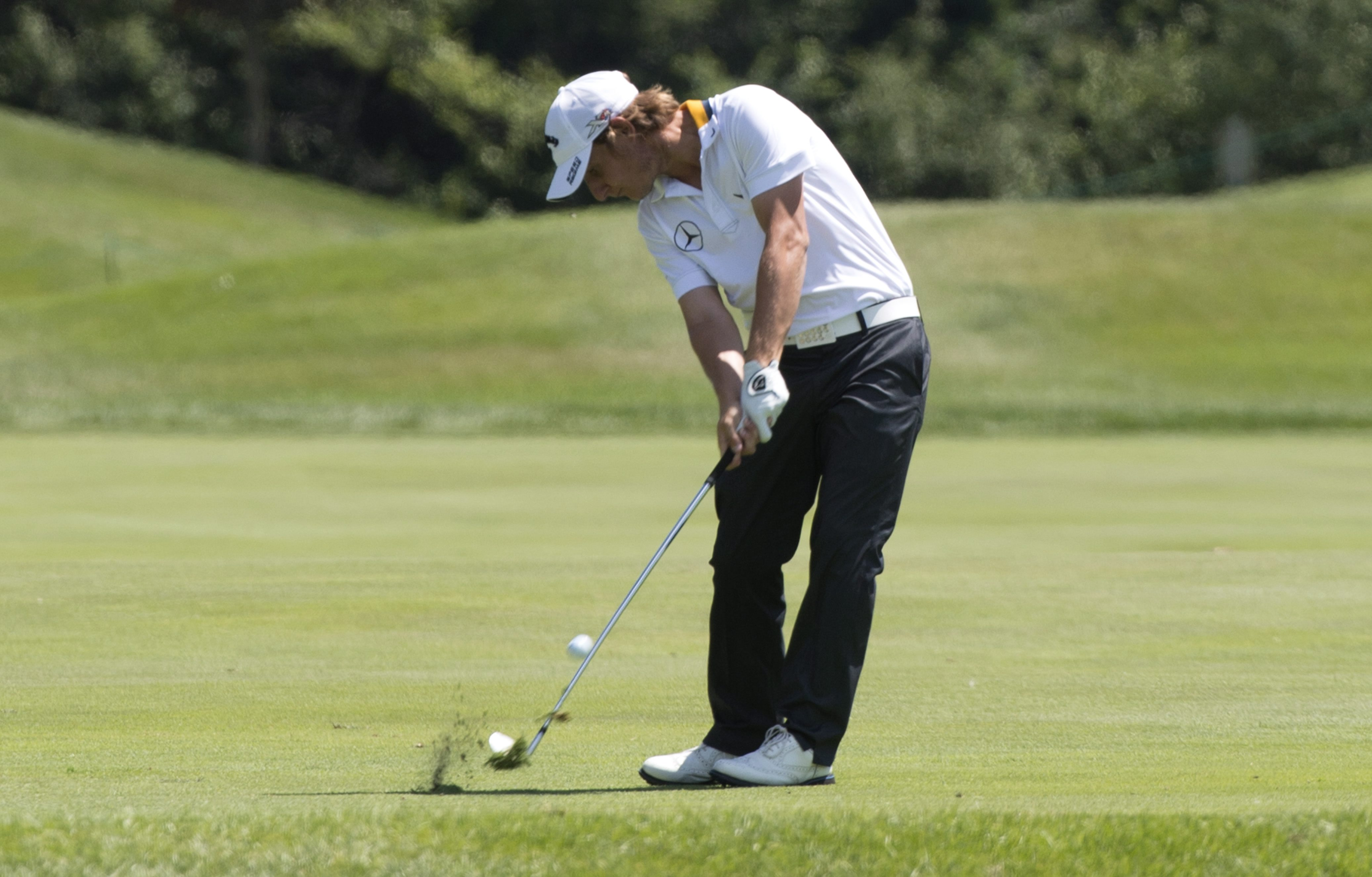Emiliano Grillo from Argentina hits on the 9th fairway during first round of play at the Canadian Open golf tournament Thursday, July 23, 2015,  in Oakville, Ontario. (Paul Chiasson/The Canadian Press via AP)