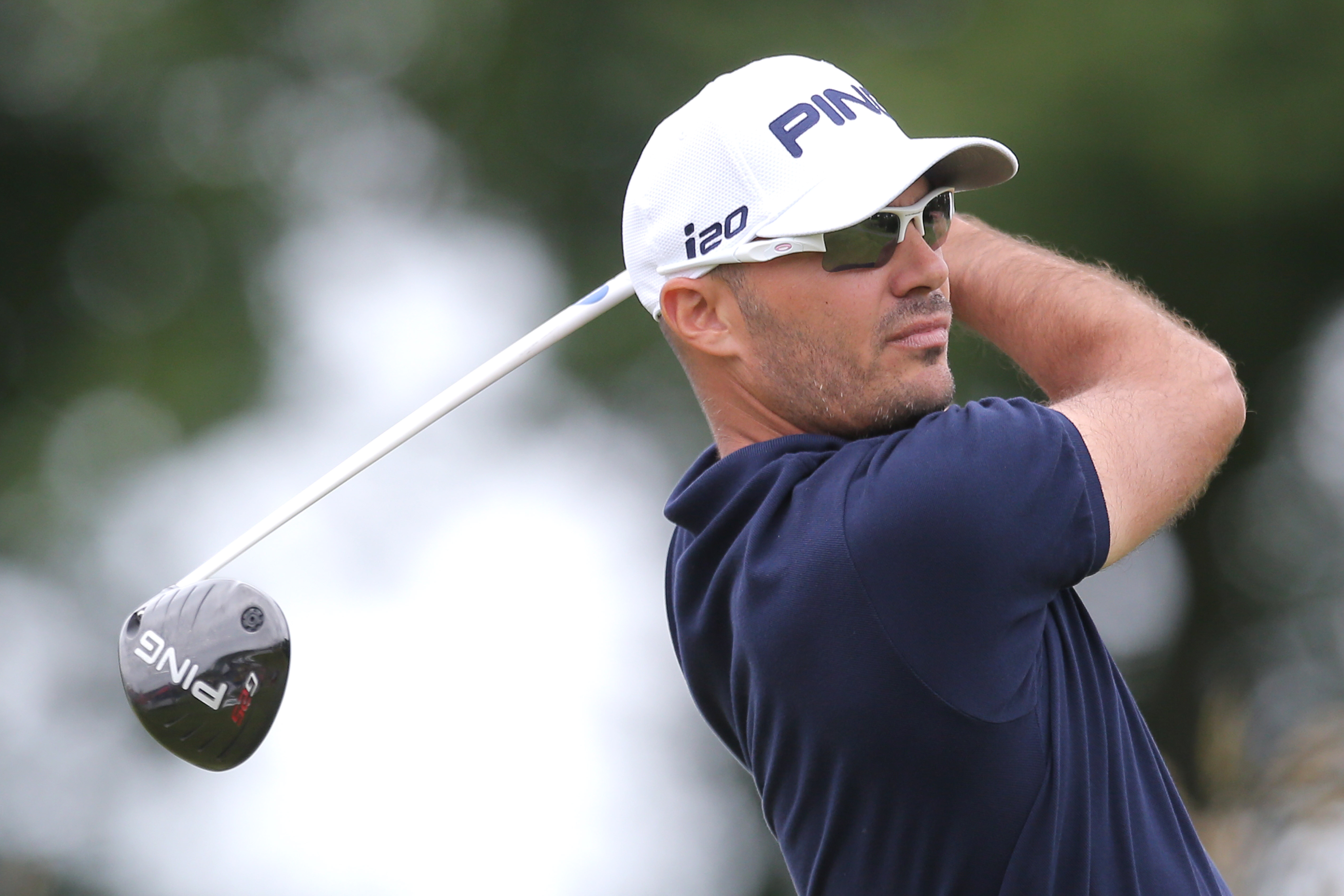Gregory Havret of France tees off the fourth hole on the first day of the French Open Golf tournament at Paris National course in Guyancourt, west of Paris, Thursday, July 4, 2013. (AP Photo/Michel Euler)