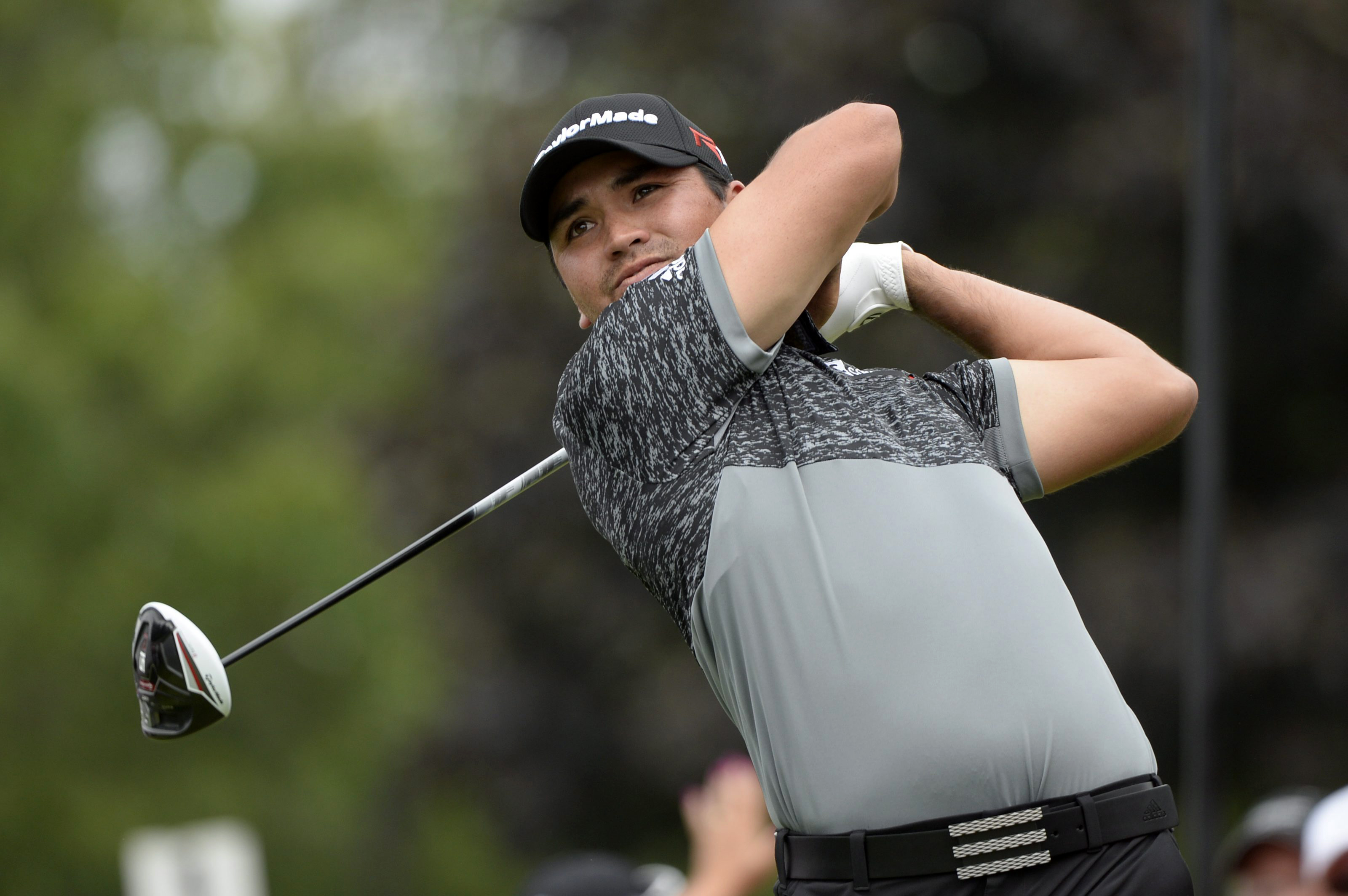 Jason Day of Australia hits off the second tee during the third round of play at the Canadian Open golf tournament in Oakville, Ontario, on Saturday, July 25, 2015. (Paul Chiasson /The Canadian Press via AP) MANDATORY CREDIT