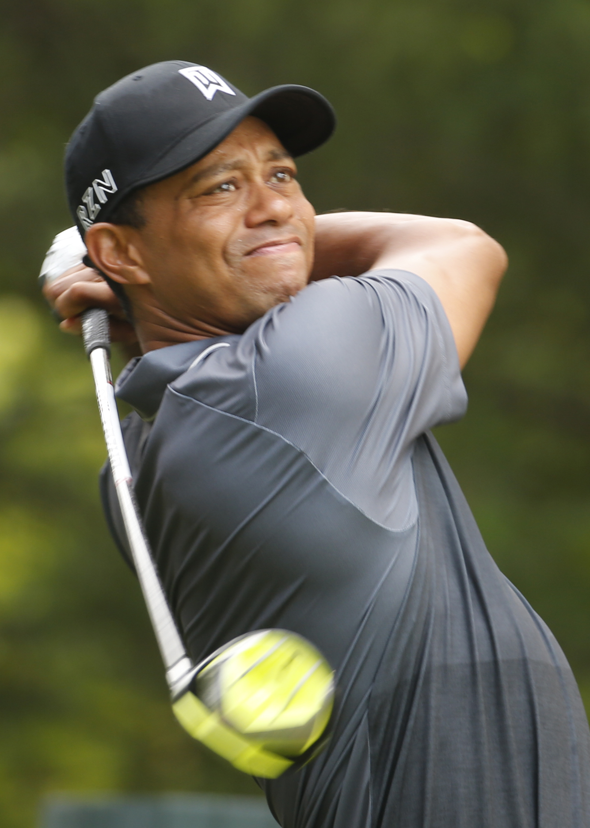 Tiger Woods watches his tee shot on the 15th hole during the pro-am for the Quicken Loans National Golf tournament at the Robert Trent Jones Golf Club in Gainesville, Va., Wednesday, July 29, 2015.  (AP Photo/Steve Helber)