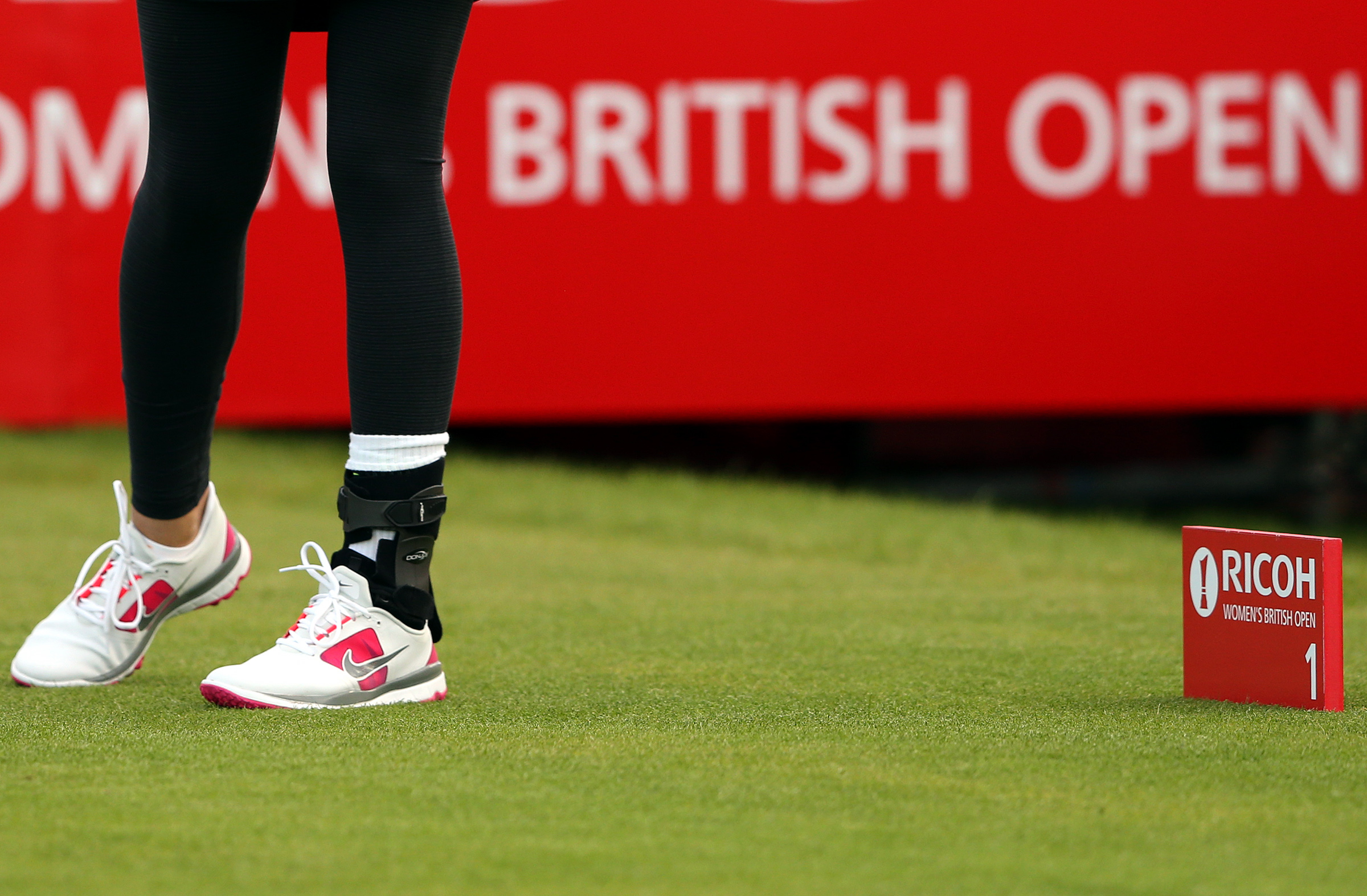 Michelle Wie of the U.S. is seen wearing a ankle brace as she tees off from the first hole during the first day of the Women's British Open golf championship on the Turnberry golf course in Turnberry, Scotland, Thursday, July 30, 2015. (AP Photo/Scott Hep