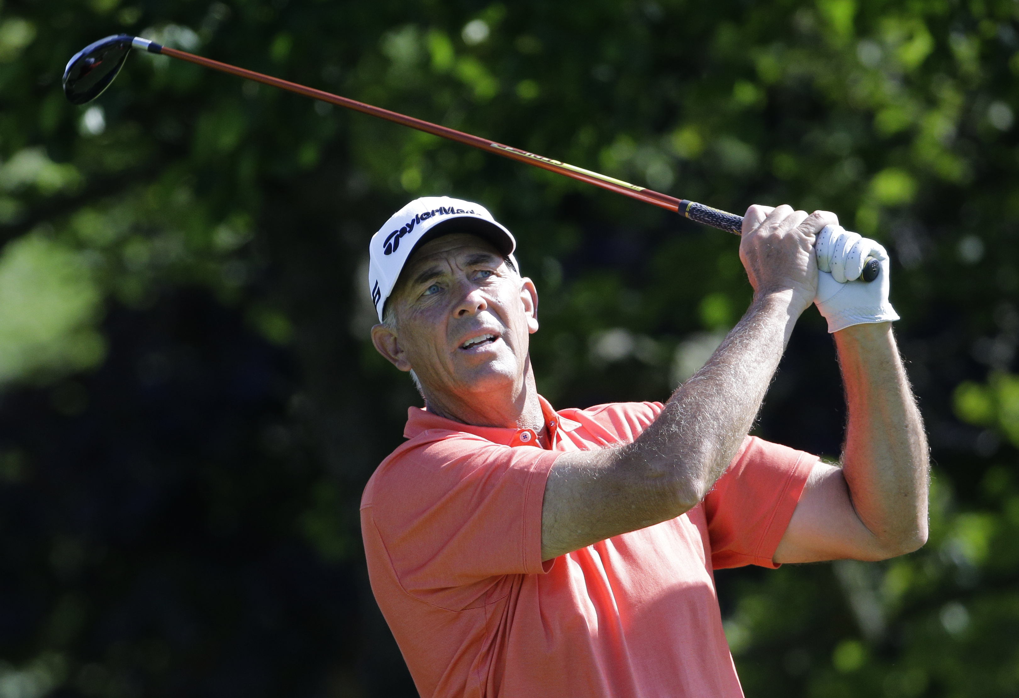 Tom Lehman watches his tee shot on the 13th during the pro-am for the Champions Tour's Encompass Championship golf tournament Thursday, July 9, 2015, in Glenview, Ill. (AP Photo/Nam Y. Huh)