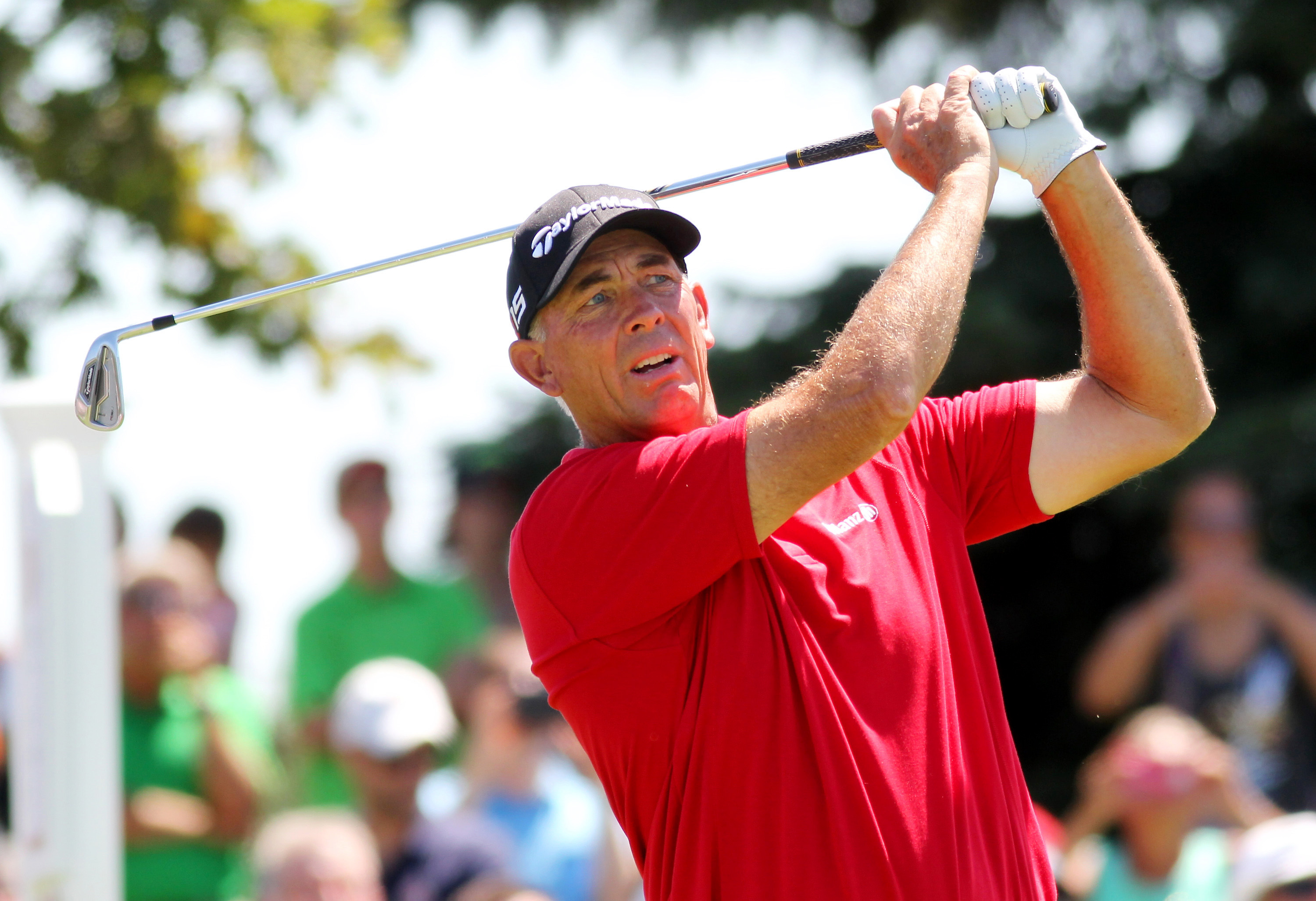 Tom Lehman tees off on the 8th hole during the second round of the Champions Tour 3M Championships golf tournament on Saturday, Aug. 1, 2015, at TPC Twins Cities in Blaine, Minn. (AP Photo/Andy Clayton King)
