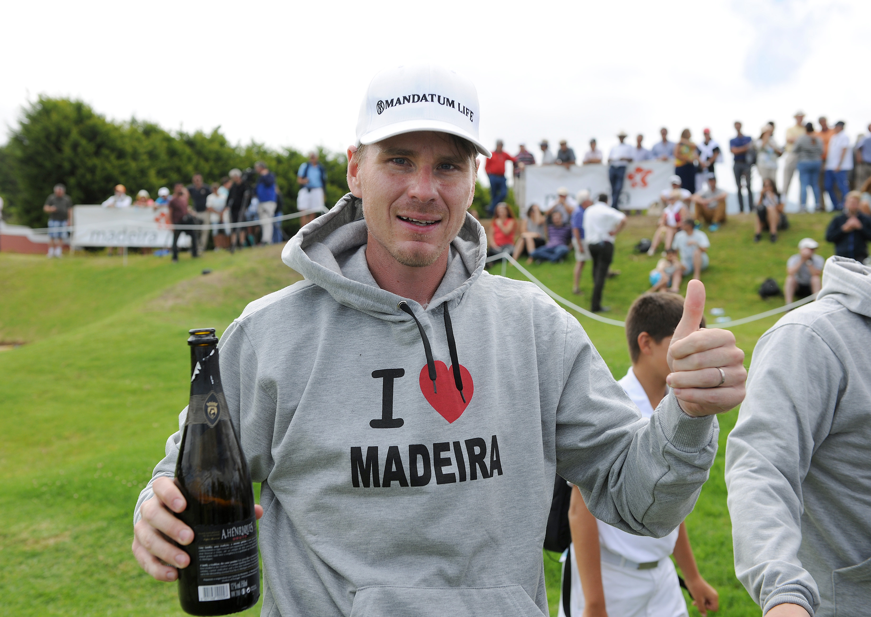 Finland's Roope Kakko celebrates after winning the Madeira Islands Golf Open at the Santo da Serra golf course in the island of Madeira, Portugal, Sunday, Aug. 2 2015. Kakko finished with a 24 under par total of 264. (AP Photo/Helder Santos)