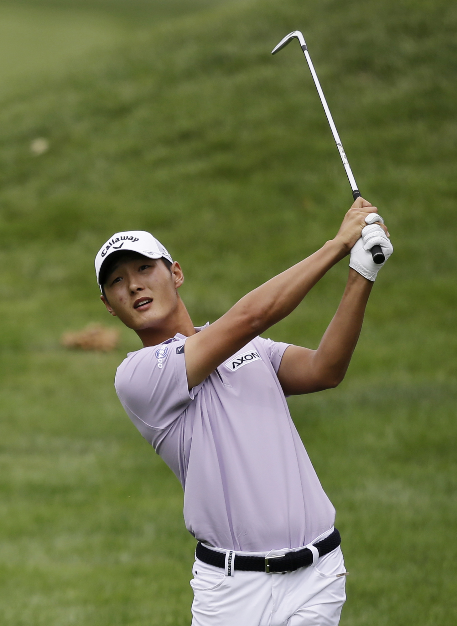 Danny Lee, from New Zealand, hits from the fairway on the 10th hole during the first round of the Bridgestone Invitational golf tournament at Firestone Country Club, Thursday, Aug. 6, 2015, in Akron, Ohio. (AP Photo/Tony Dejak)