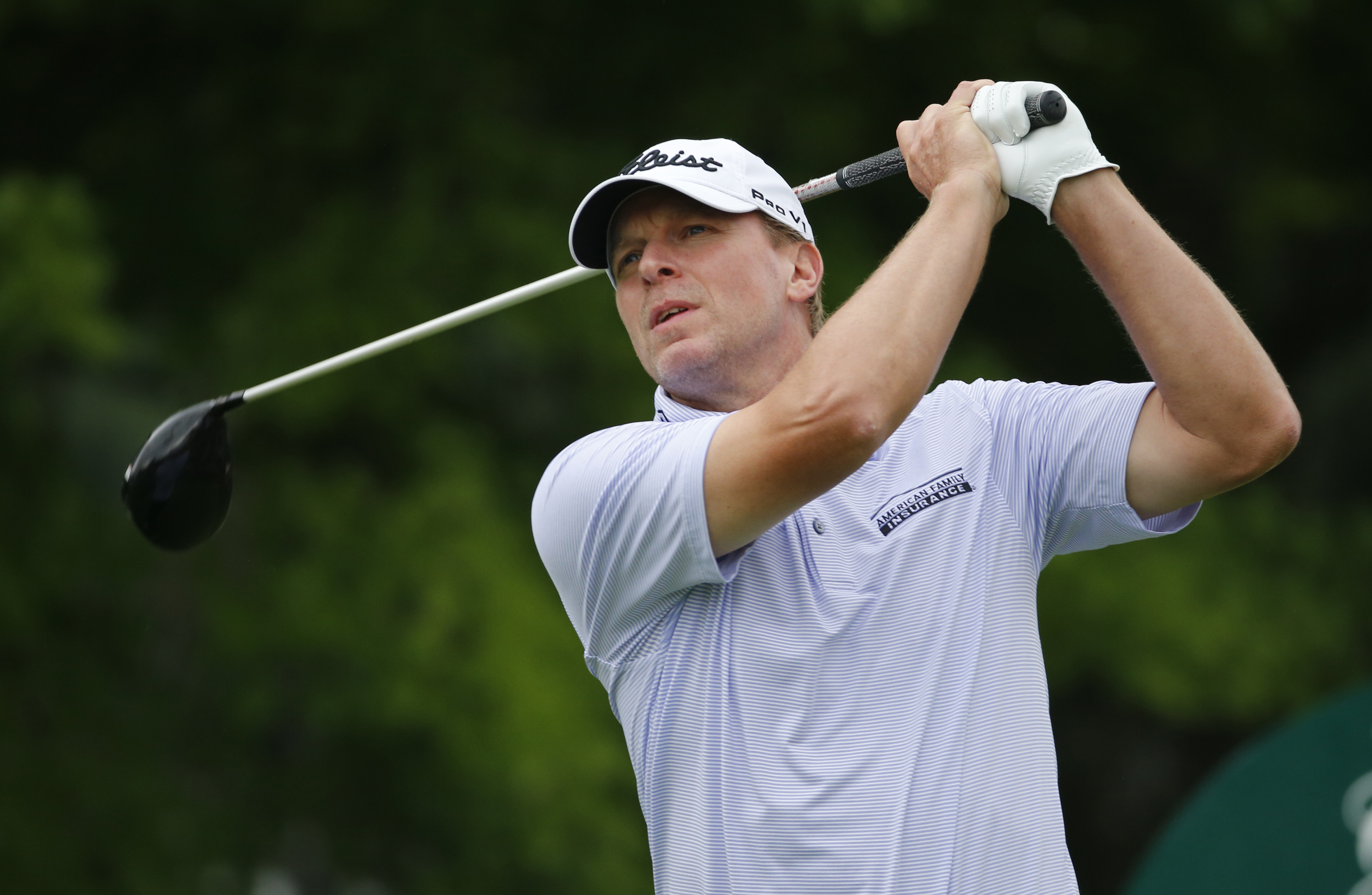 FILE - In this July 2, 2015 file photo, Steve Stricker watches his tee shot on the 12 hole during the first round of the Greenbrier Classic golf tournament at the Greenbrier Resort in White Sulphur Springs, W.Va.  Approaching the twilight of his career, t