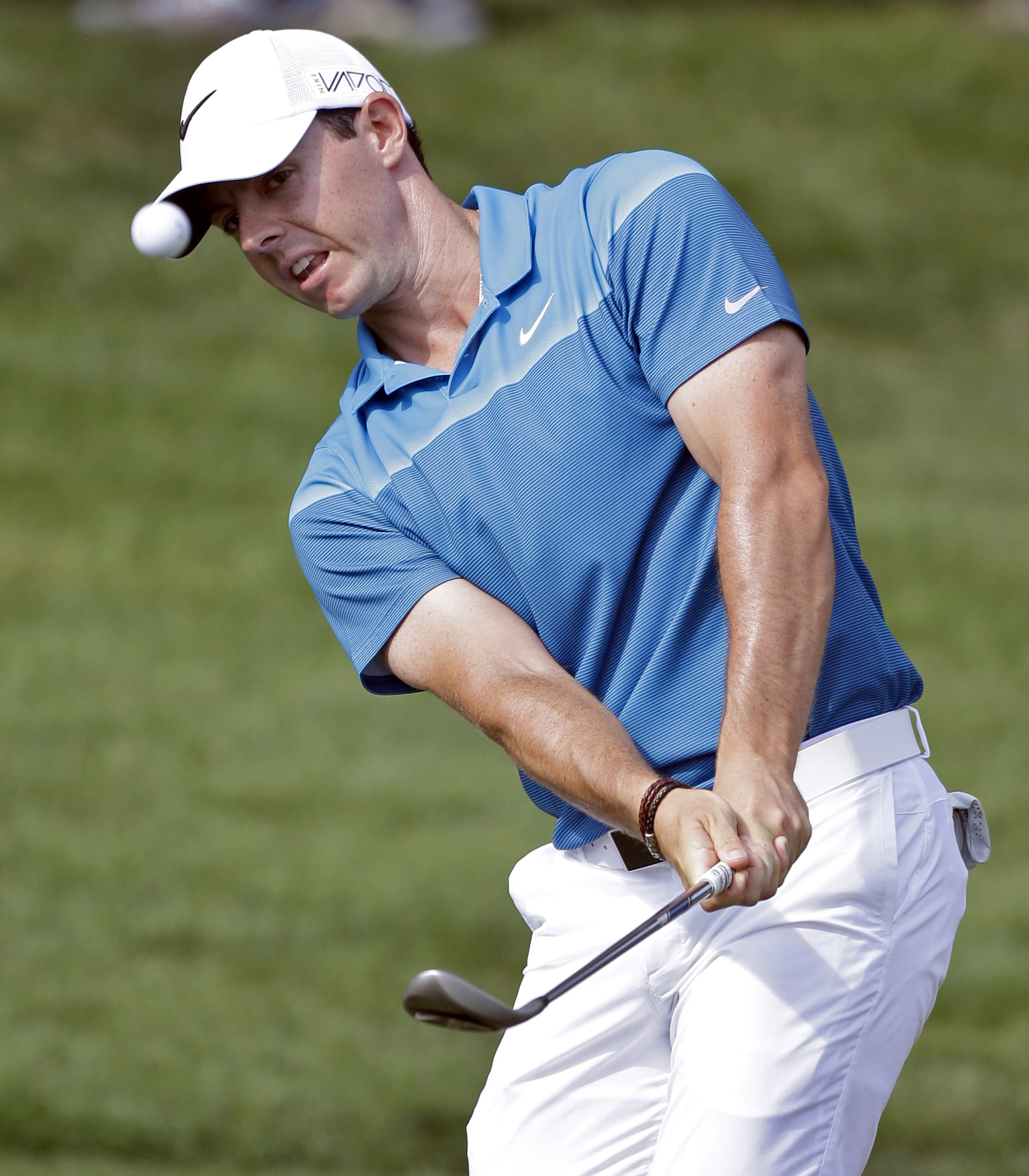 FILE - In this May 17, 2015, file photo, Rory McIlroy, of Northern Ireland, chips to the 15th green during the final round of the Wells Fargo Championship golf tournament at Quail Hollow Club in Charlotte, N.C. World number one McIlroy looks increasingly