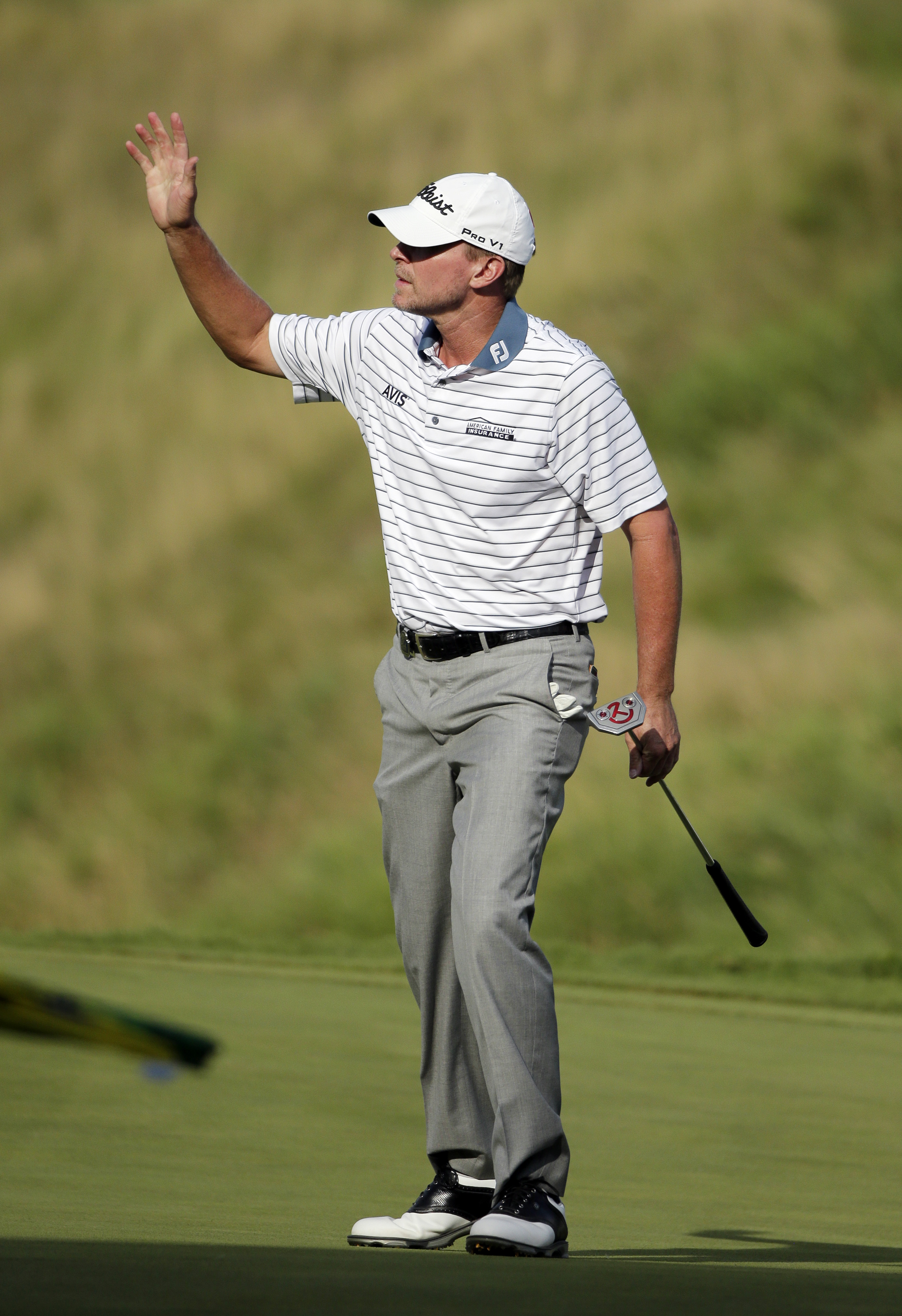 Steve Stricker waves after a birdie on the 18th hole during the first round of the PGA Championship golf tournament Thursday, Aug. 13, 2015, at Whistling Straits in Haven, Wis. (AP Photo/Chris Carlson)