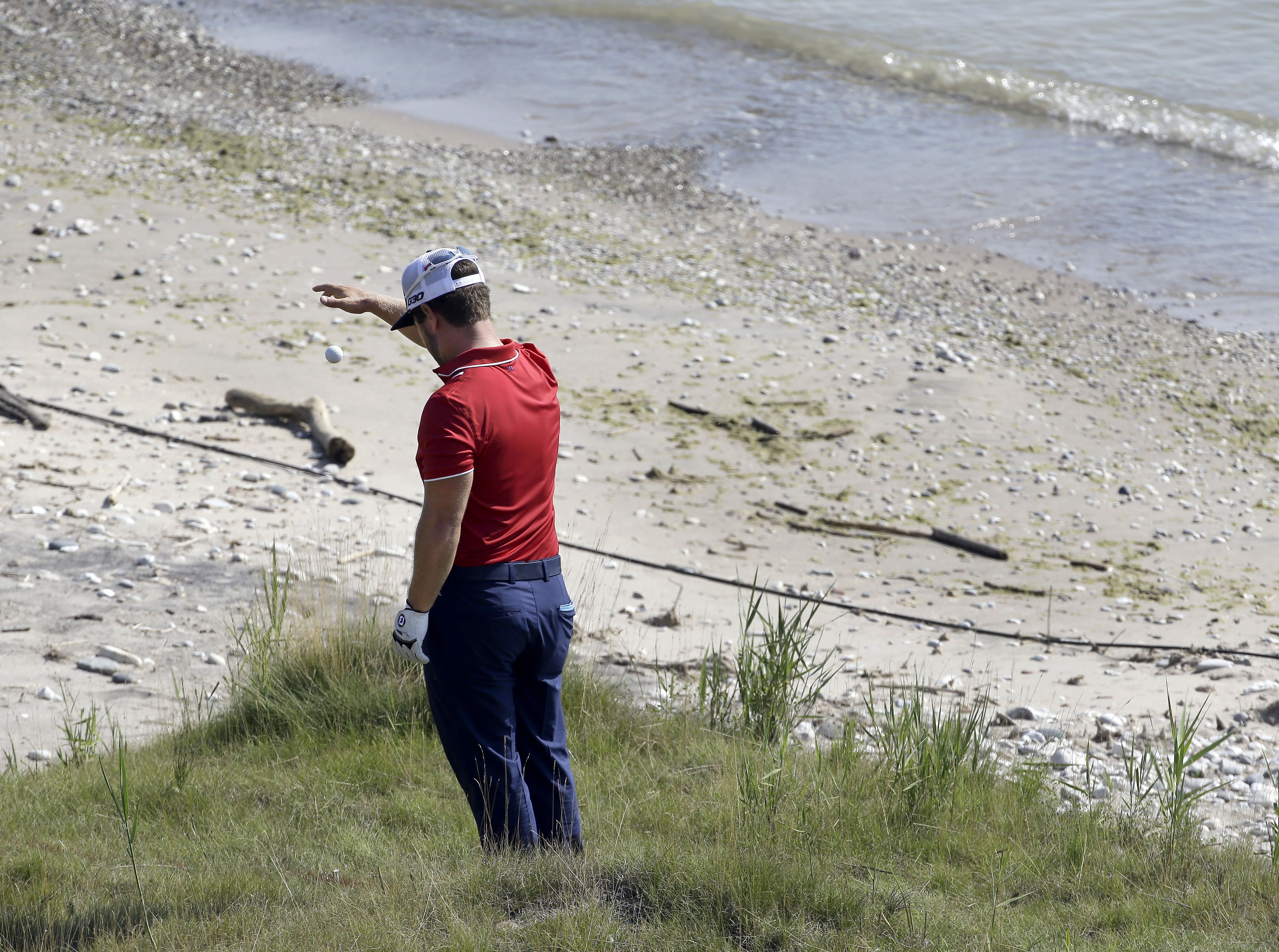 CORRECTS TO SEVENTH HOLE, NOT 17TH - David Lingmerth, of Sweden, takes a drop on the seventh hole during the second round of the PGA Championship golf tournament Friday, Aug. 14, 2015, at Whistling Straits in Haven, Wis. (AP Photo/Brynn Anderson)