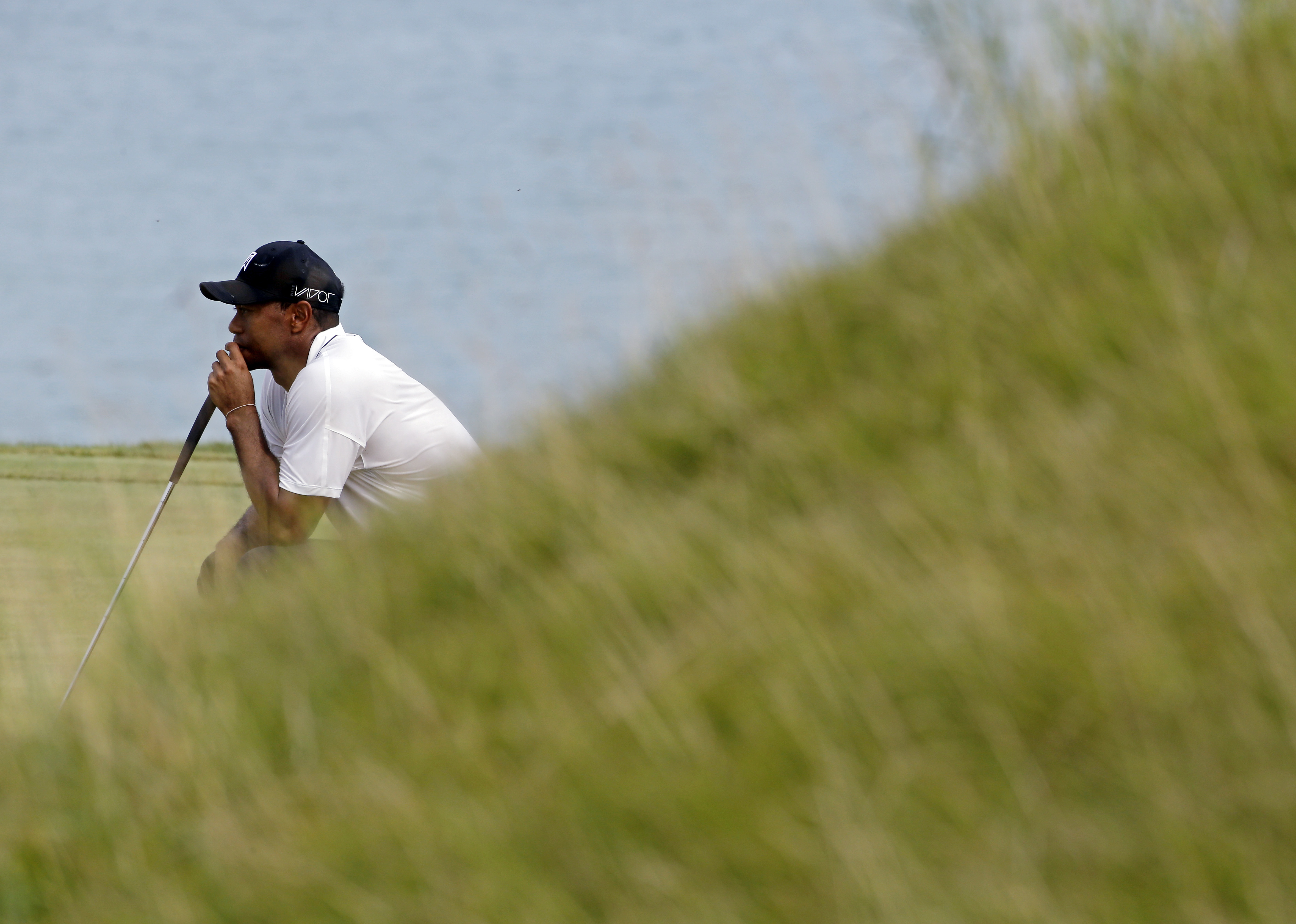 Tiger Woods waits to putt on the eighth hole during the second round of the PGA Championship golf tournament Friday, Aug. 14, 2015, at Whistling Straits in Haven, Wis. (AP Photo/Brynn Anderson)