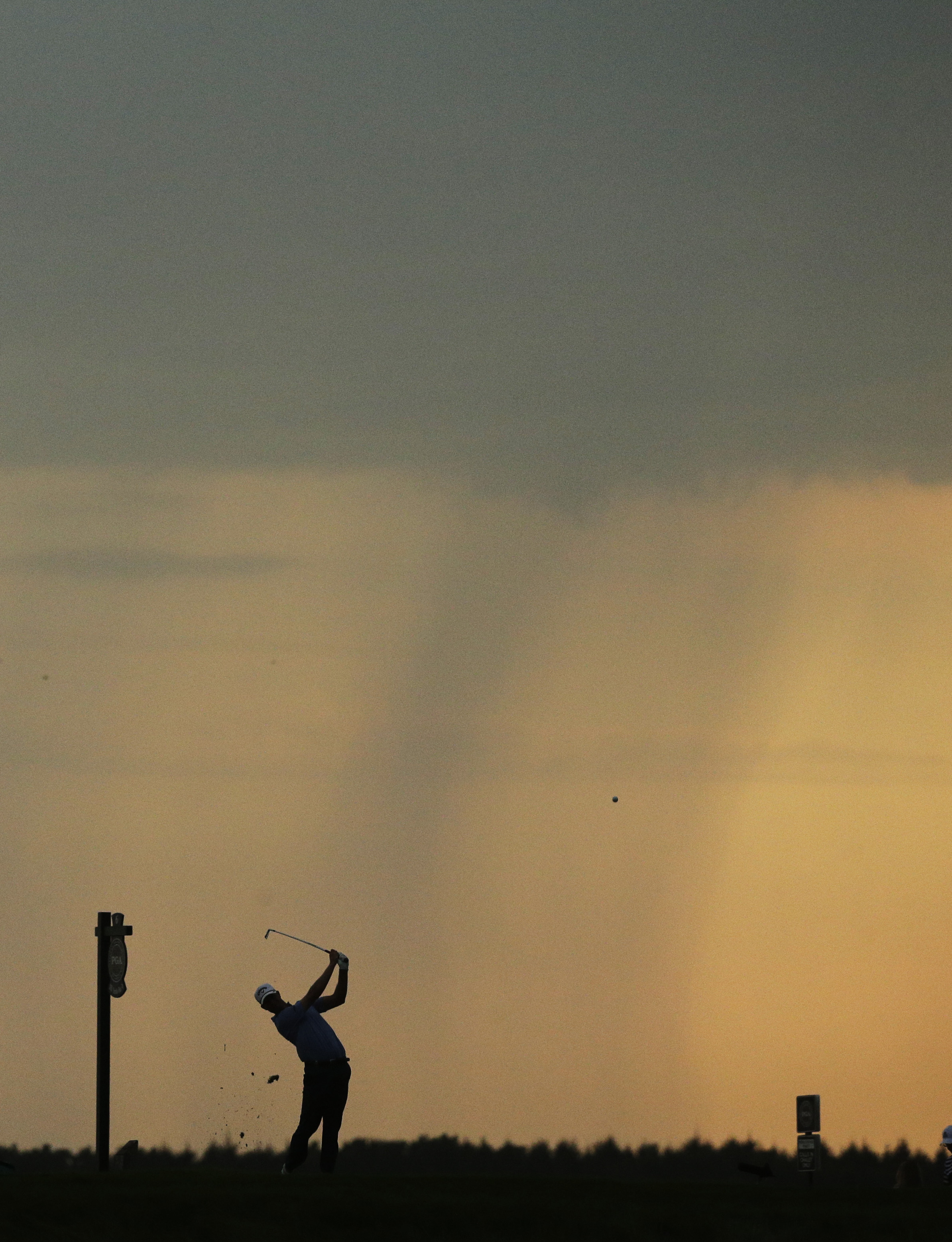 Harris English hits off the with tee as weather rolls in during the second round of the PGA Championship golf tournament Friday, Aug. 14, 2015, at Whistling Straits in Haven, Wis. Play was suspended. (AP Photo/Jae Hong)
